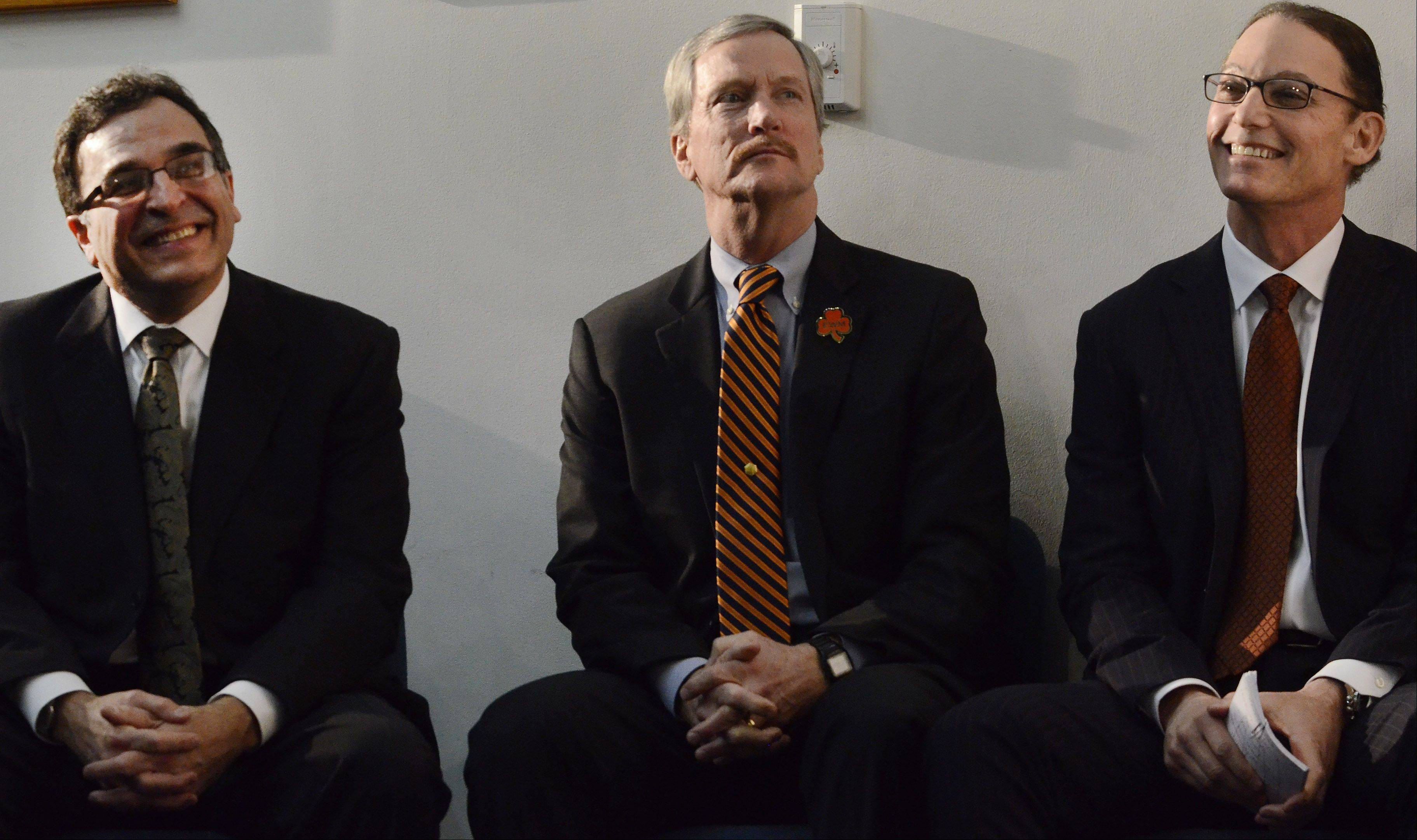 Ted Phillips, George McCaskey and Marc Trestman, before Trestman is named the 14th head coach of the Chicago Bears.