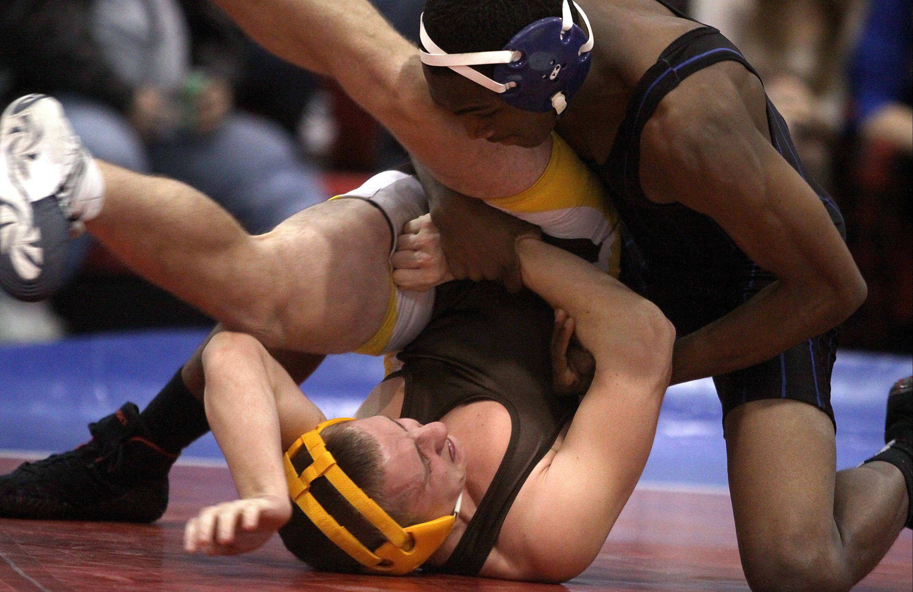 Jacobs' Dalton Baran, bottom, struggles under the control of Dundee-Crown's Martell Thompson during their 138-pound match at Carpentersville on Thursday night. Thompson won the match with a pin.