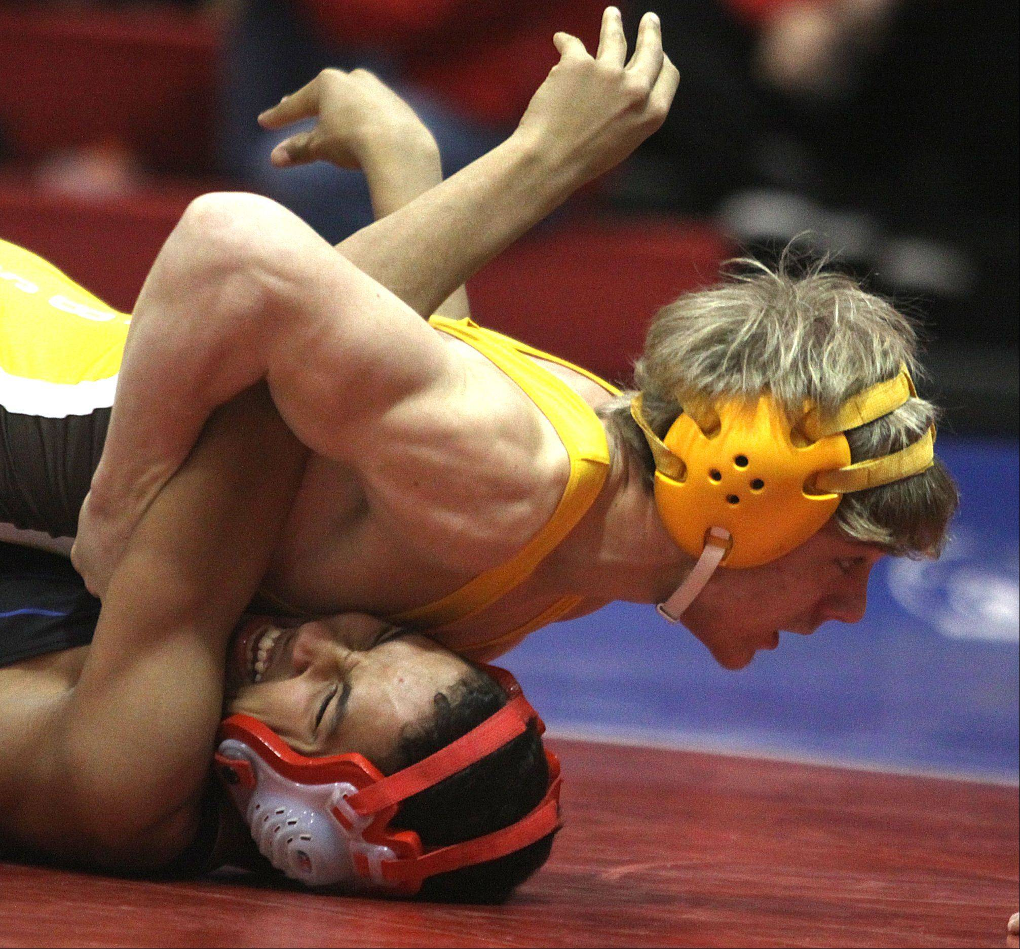 Jacobs' Cody Ferencz, top, pins Dundee-Crown's Raymond Turskey during their 126-pound match at Carpentersville on Thursday night.