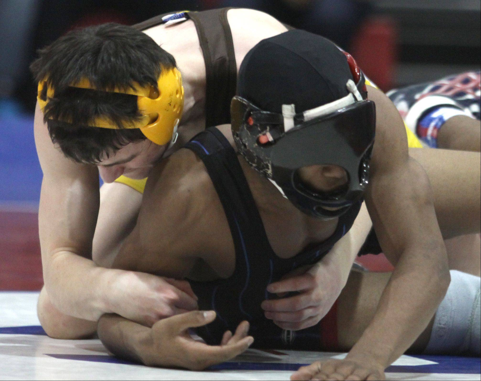 Jacobs' Kenny Thompson, left, battles with Dundee-Crown's Jequan Flynn during their 120-pound match at Carpentersville on Thursday night. Thompson won the match.