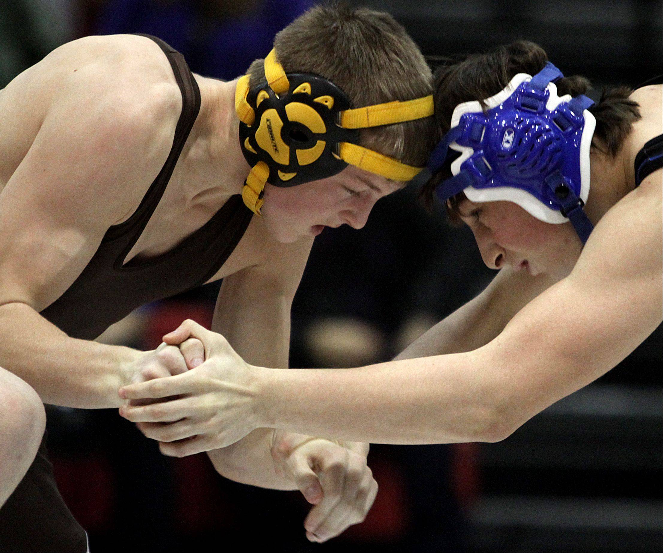 Jacobs' Michael Ricks, left, battles Dundee-Crown's Elijah Velez during their 145-pound match at Carpentersville on Thursday night. Ricks won the match.