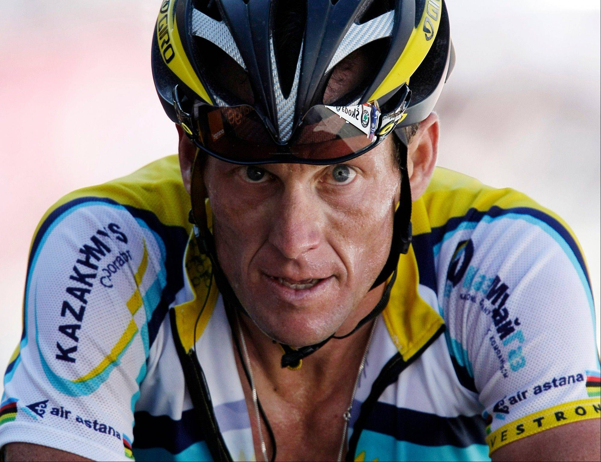 In this July 19, 2009, file photo, Lance Armstrong crosses the finish line during the 15th stage of the Tour de France cycling race in Verbier, Switzerland. Armstrong confessed to using performance-enhancing drugs to win the Tour de France during a taped interview with Oprah Winfrey that aired Thursday, reversing more than a decade of denial.