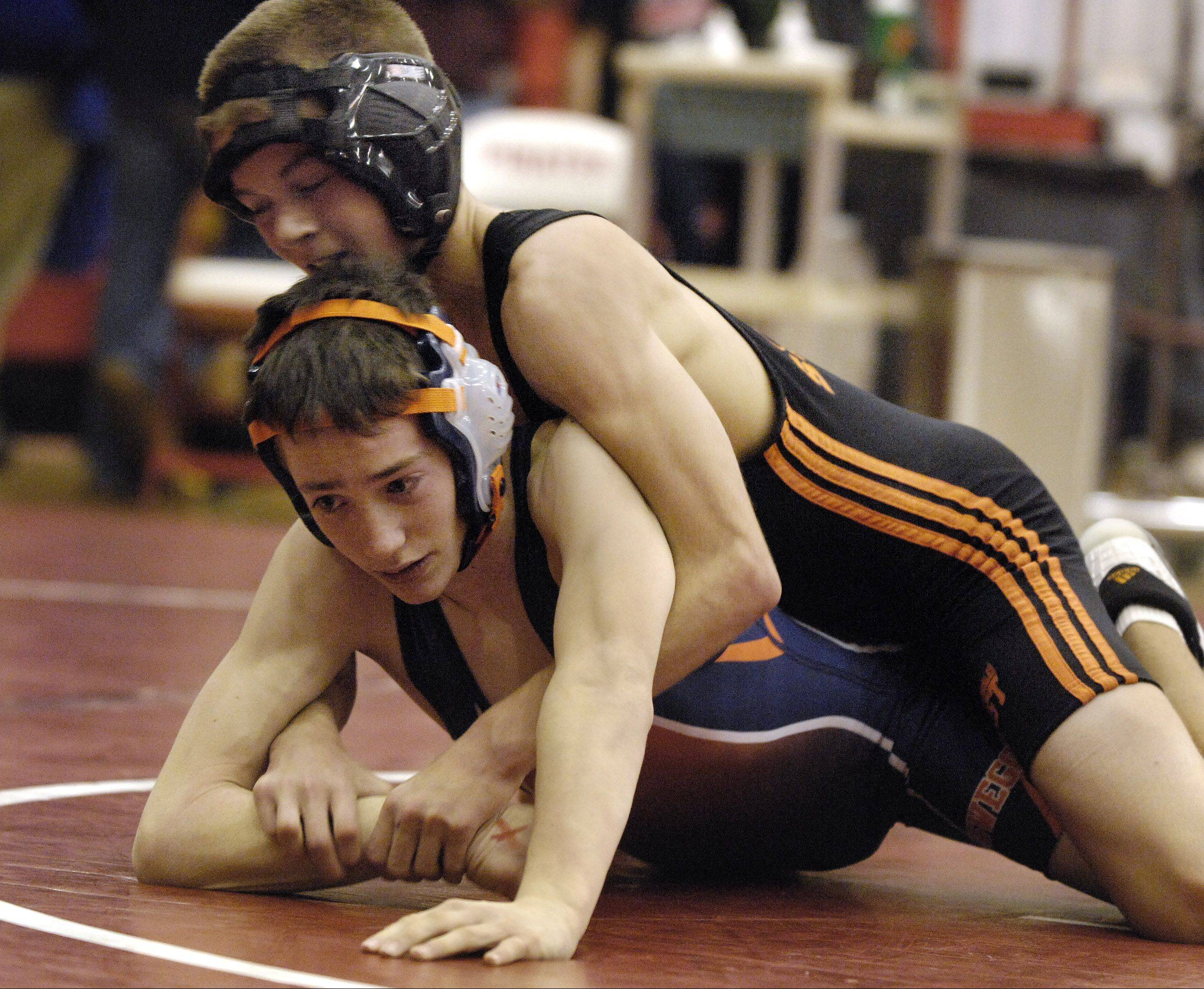 St. Charles East's Brad Kearbey, top, pictured earlier in his high school career, is up to 160 pounds where he has a 20-7 record for the 15-