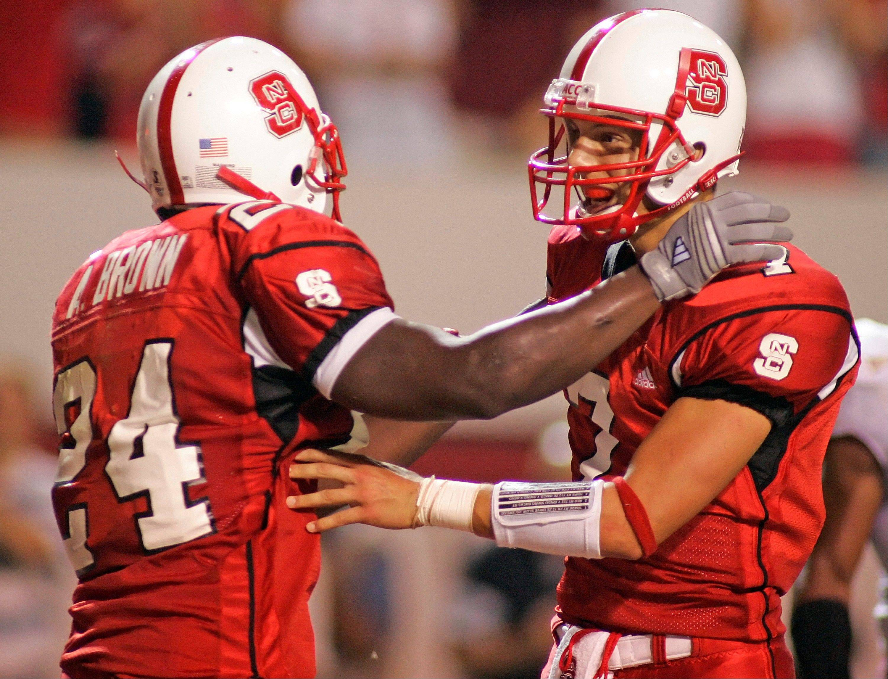 From 2005-06, Trestman served as offensive coordinator of North Carolina State, where the Wolfpack went 10-14 during his tenure. North Carolina State quarterback Daniel Evans, right, congratulates runningback Andre Brown in a win against Boston College in 2006.