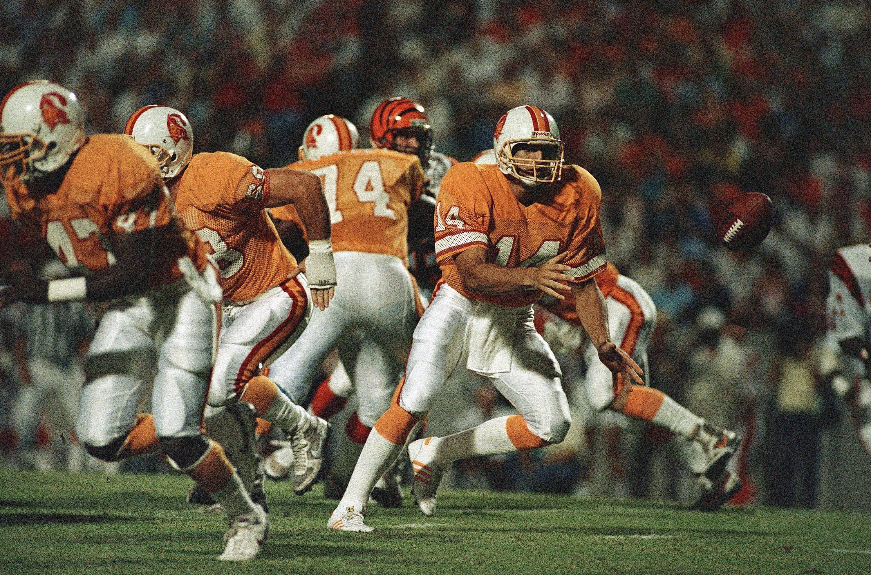 Trestman helped Vinny Testeverde, above, make his NFL debut with the Tampa Bay Buccaneers in 1987.