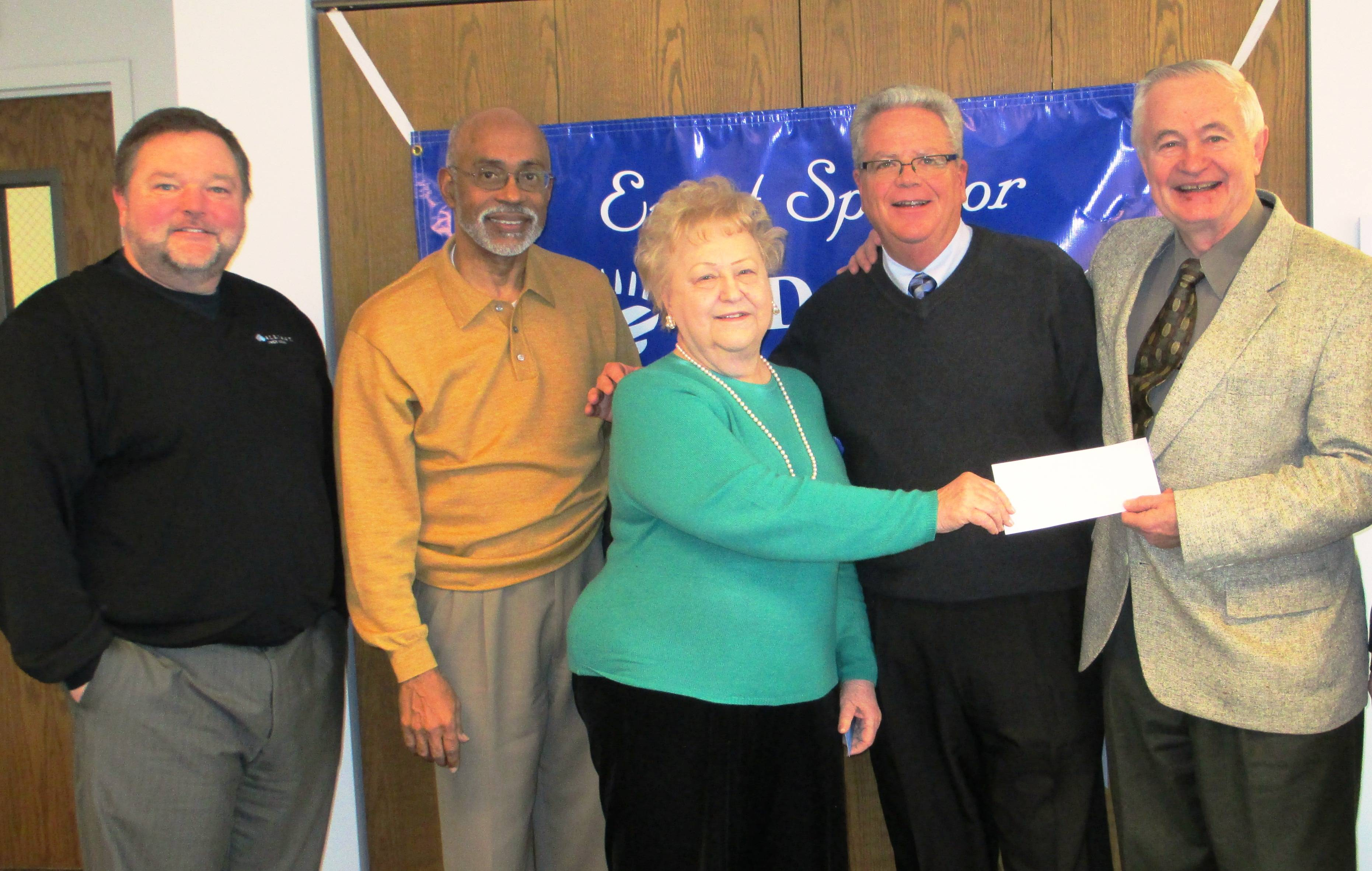 From left, Rich Holke, Alliant Credit Union; Charles L. Reid, Pastor Bethesda Worship Center; Rosemary Argus, Executive Director of the Des Plaines Community Foundation; Dan Fink, Juno Lighting Group and Eckhard Blaumueller