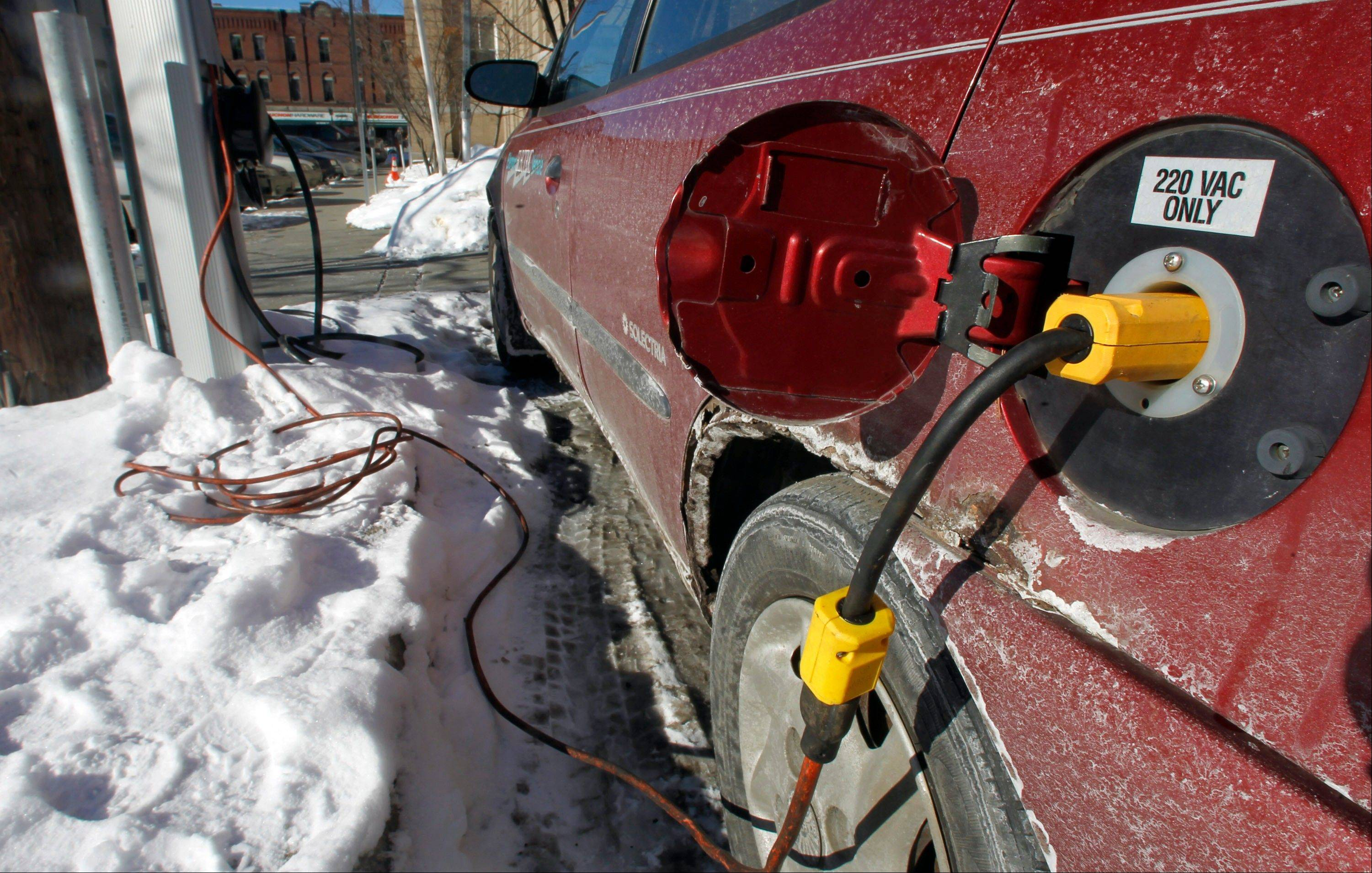 An electric car is charged on Friday in Montpelier, Vt. Carpooling, higher fuel economy, hybrids and electric cars may be good for the environment, but they�re bad for government transportation funding, which relies on gasoline and diesel taxes to help pay for the building and upkeep of roads and bridges.