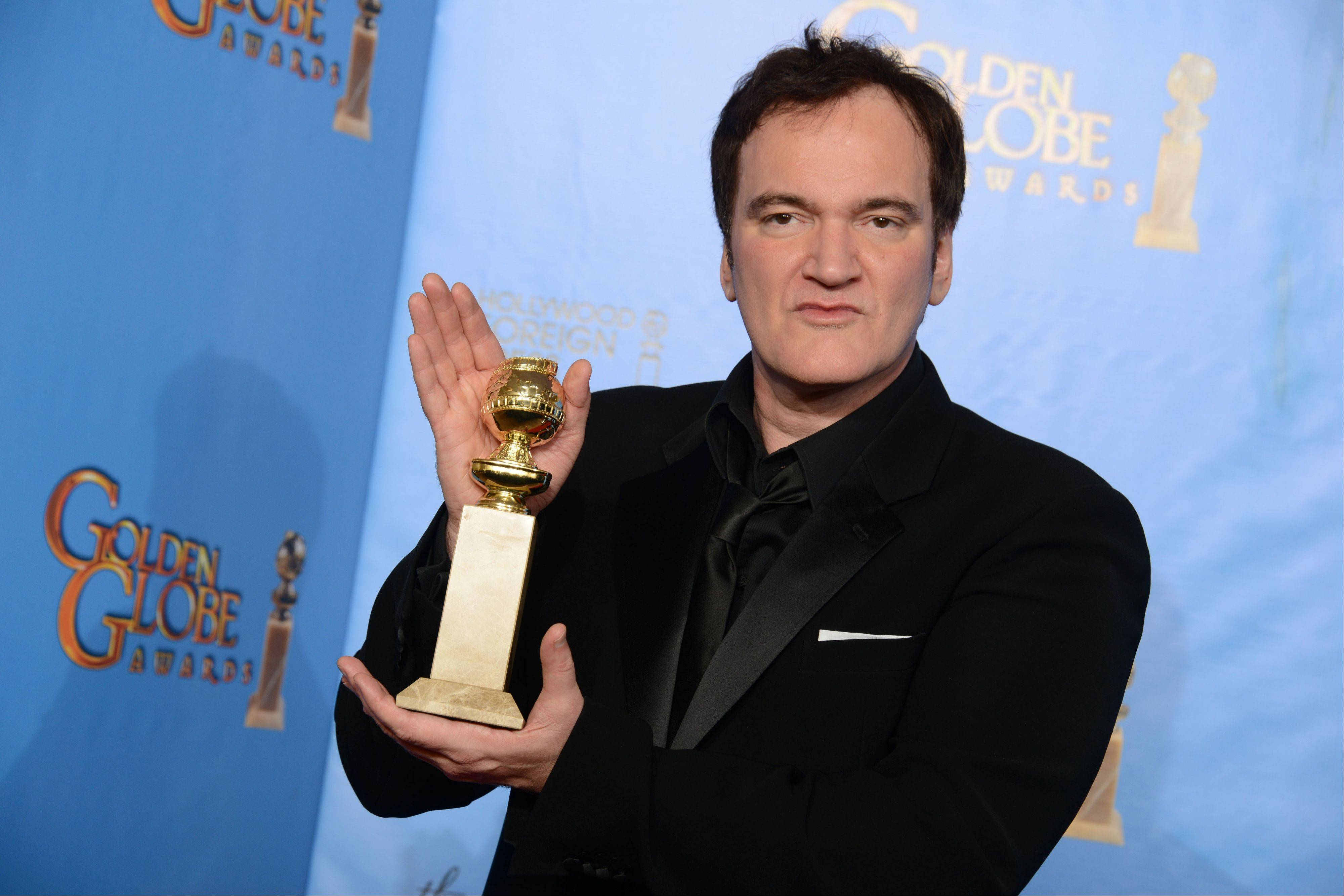 Associated Press Quentin Tarantino poses with the award for best screenplay for a motion picture for �Django Unchained� backstage last Sunday at the 70th Annual Golden Globe Awards at the Beverly Hilton Hotel.