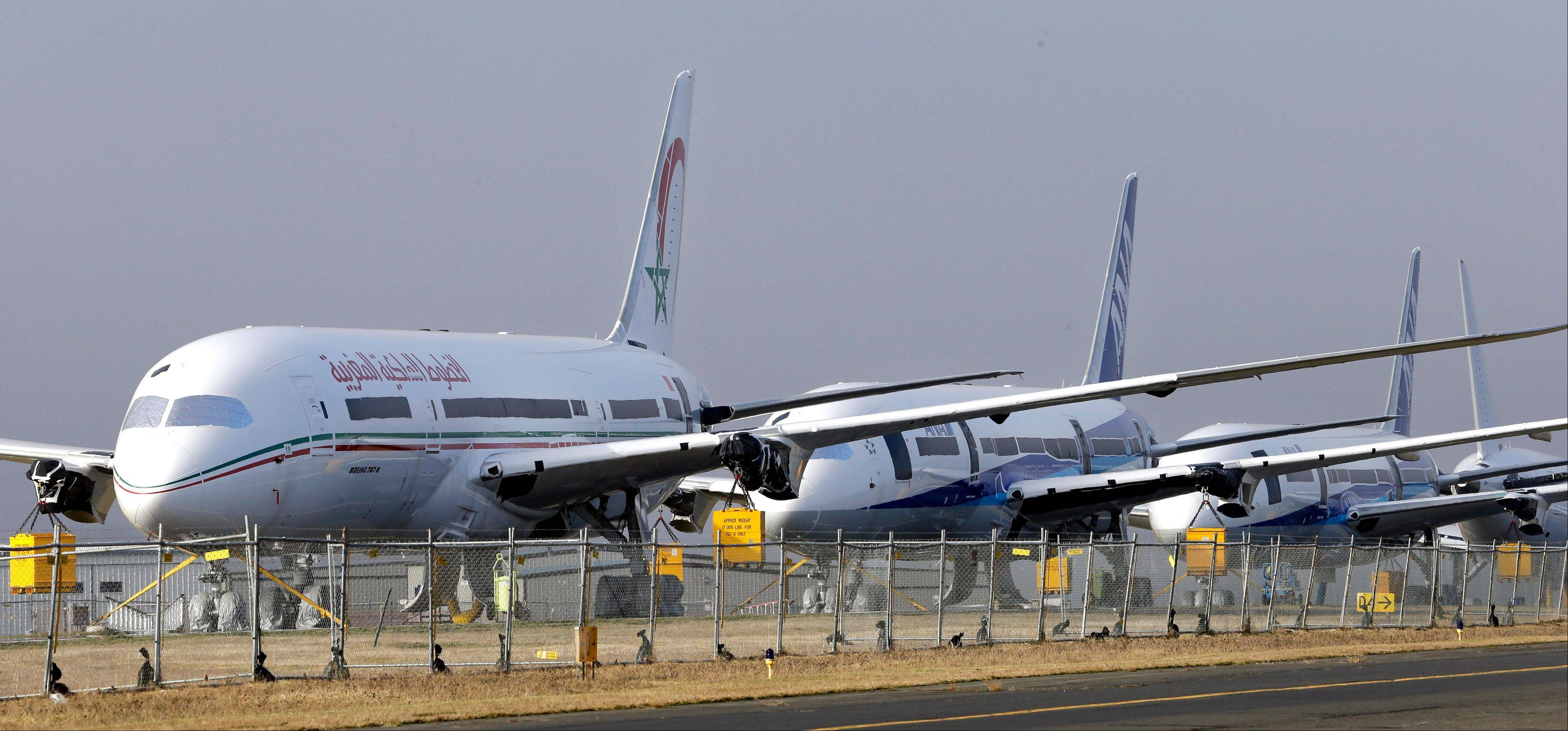 A line of 787 jets are parked Thursdayat Paine Field in Everett, Wash.