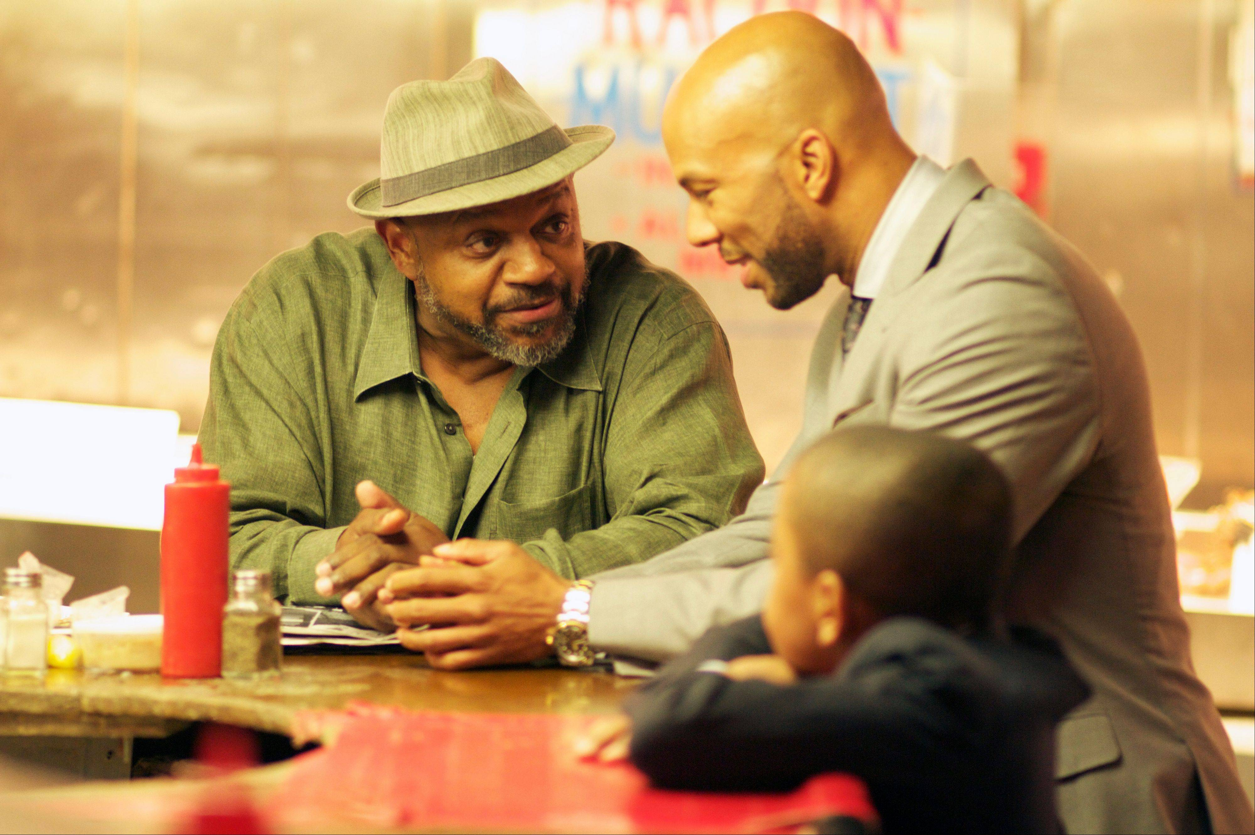 "Ex-con Vincent (Common), center, takes his nephew Woody (Michael Rainey Jr.) around town as he meets up with friends and associates in ""LUV,"" also starring Charles S. Dutton, left."