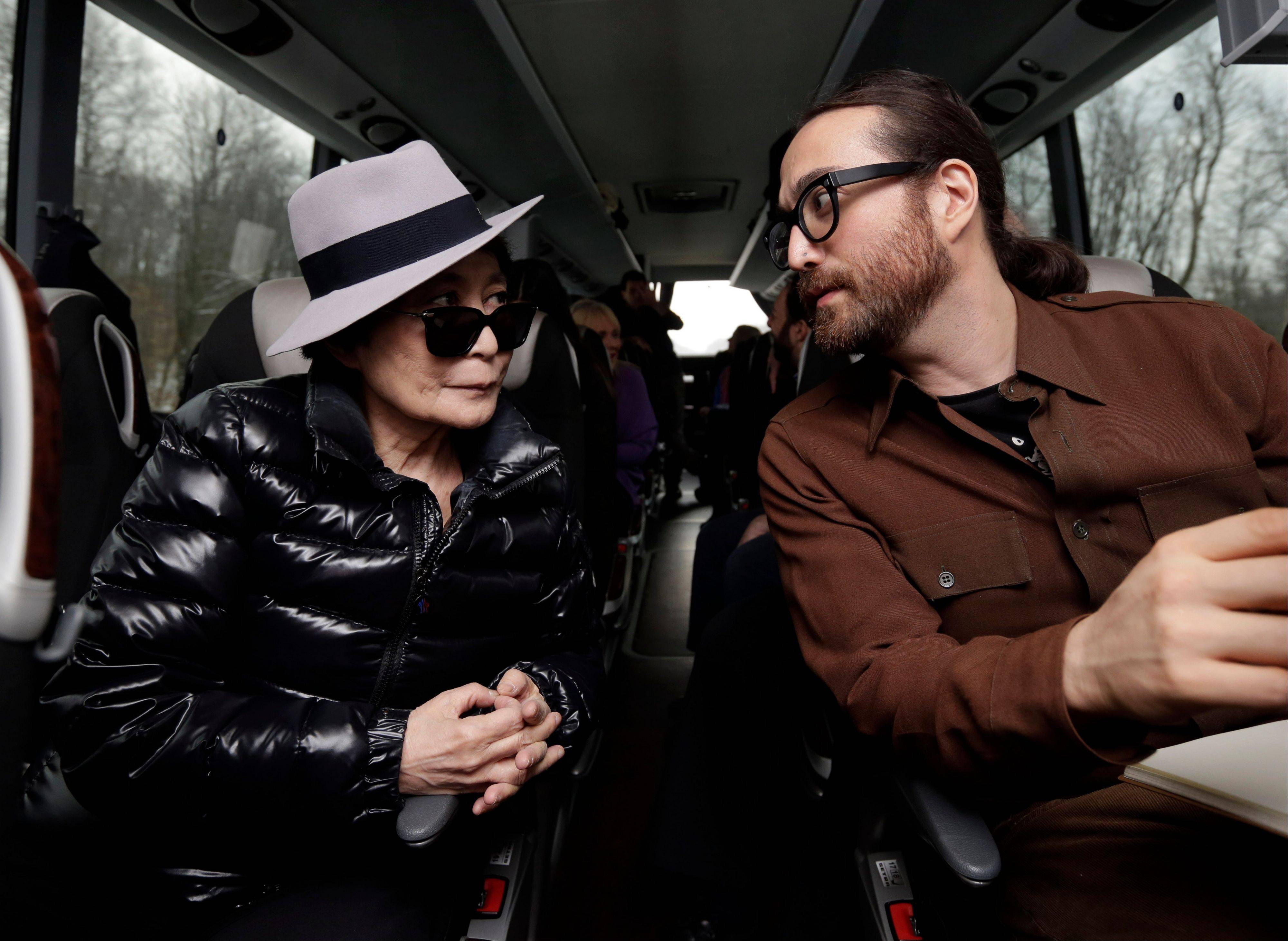 Yoko Ono, left, and her son Sean Lennon chat aboard a bus Thursday on the way to visit fracking sites in Pennsylvania.