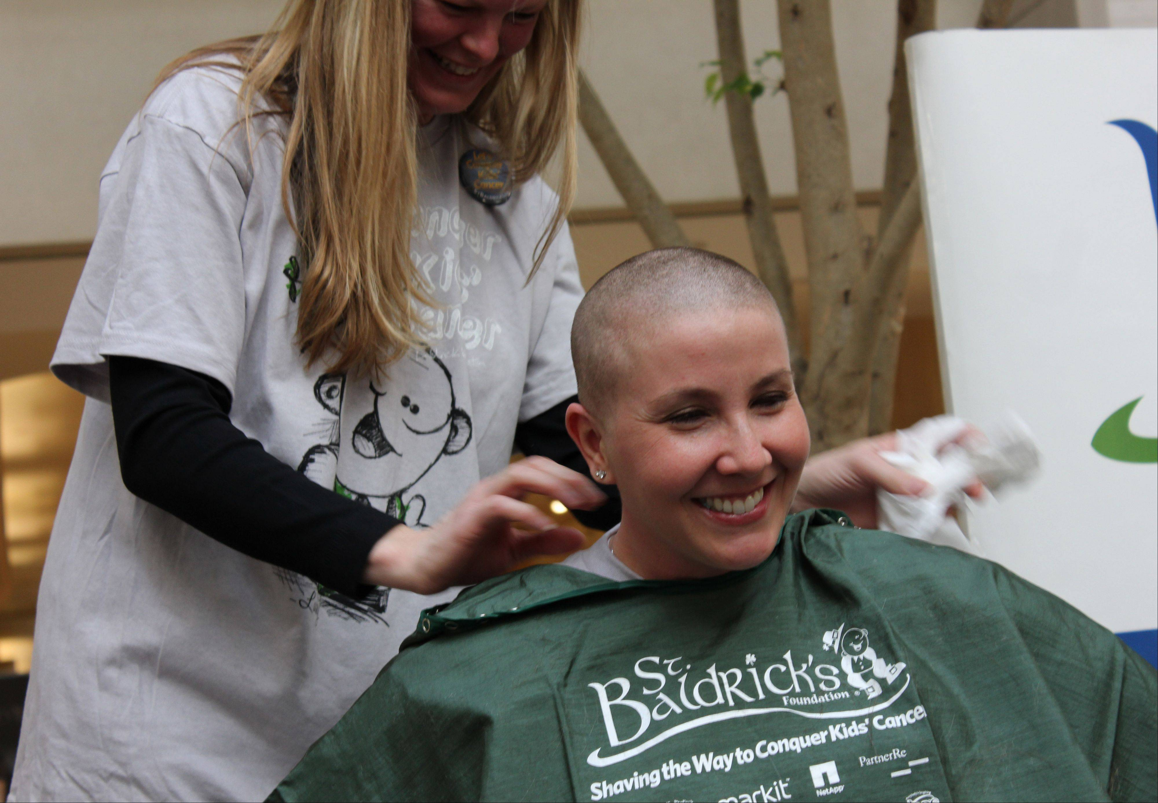 Officer Rebecca Foy volunteered for a head shave at the 2012 event and raised more than $3,000.