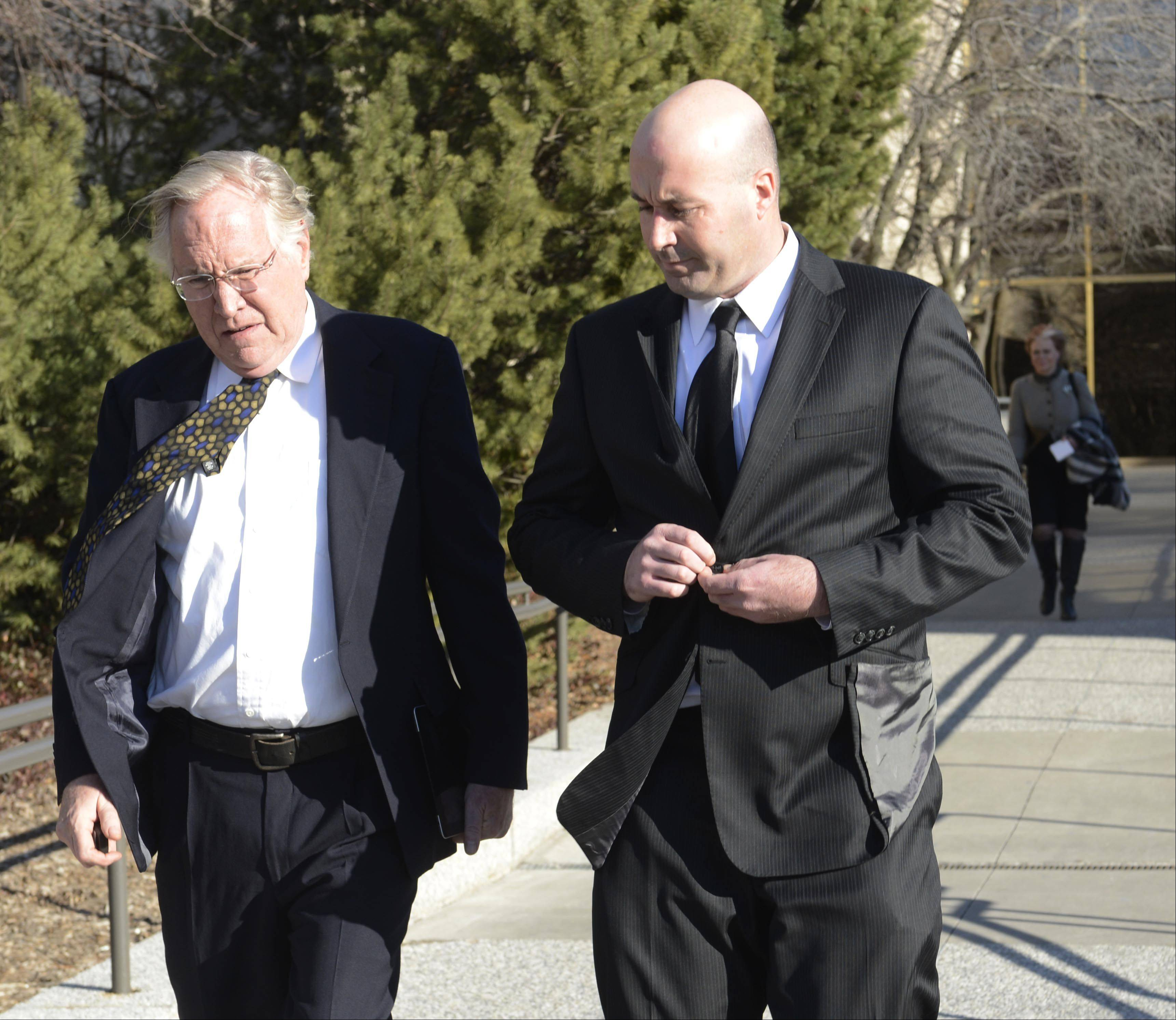 Richard Vanecko, right, who has been charged with involuntary manslaughter in the 2004 death of David Koschman of Mount Prospect, leaves the Rolling Meadows courthouse with one of his attorneys, Terence Gillespie, after a hearing Friday.