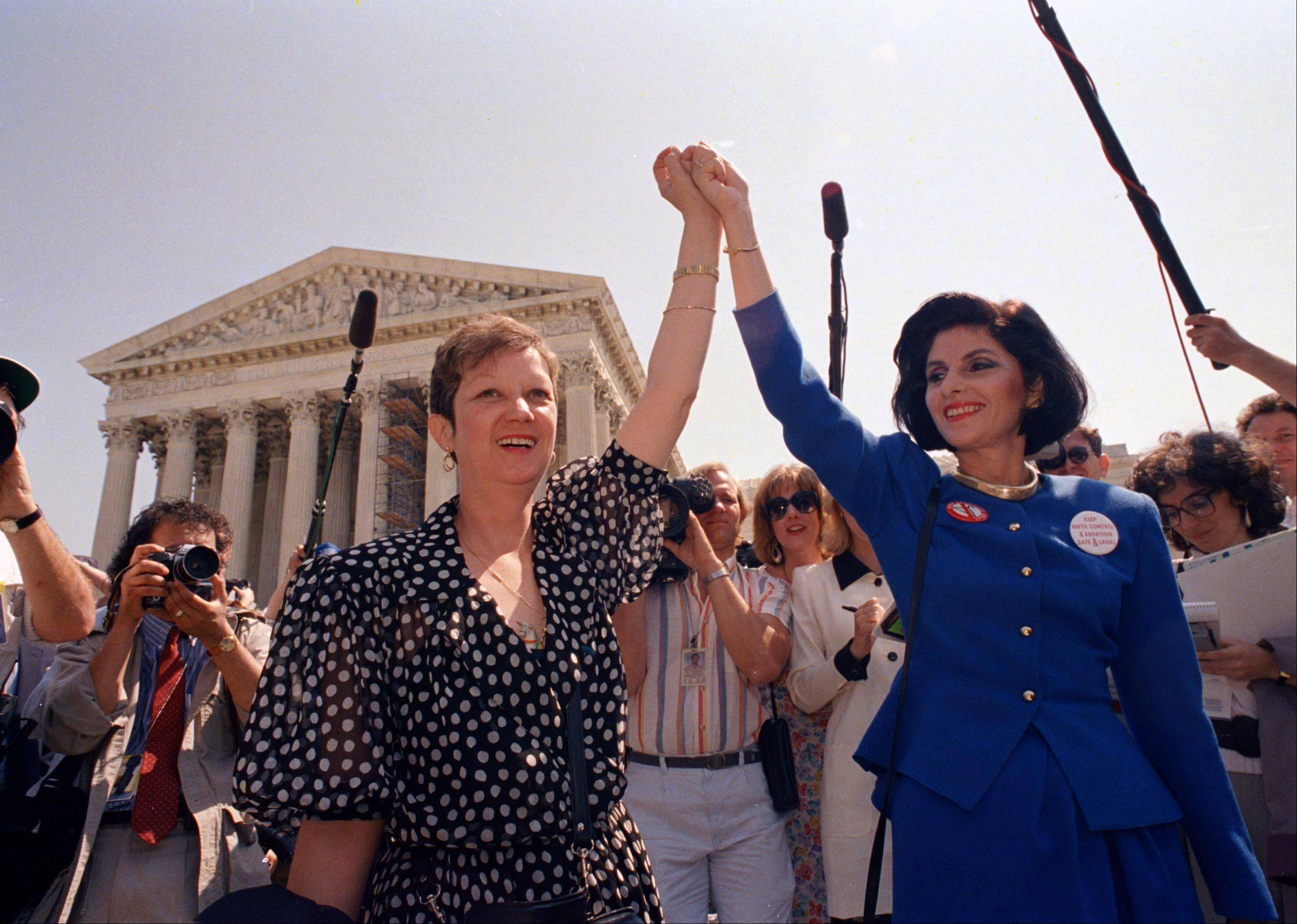Protesters at the Supreme Court decry abortion in 1986.