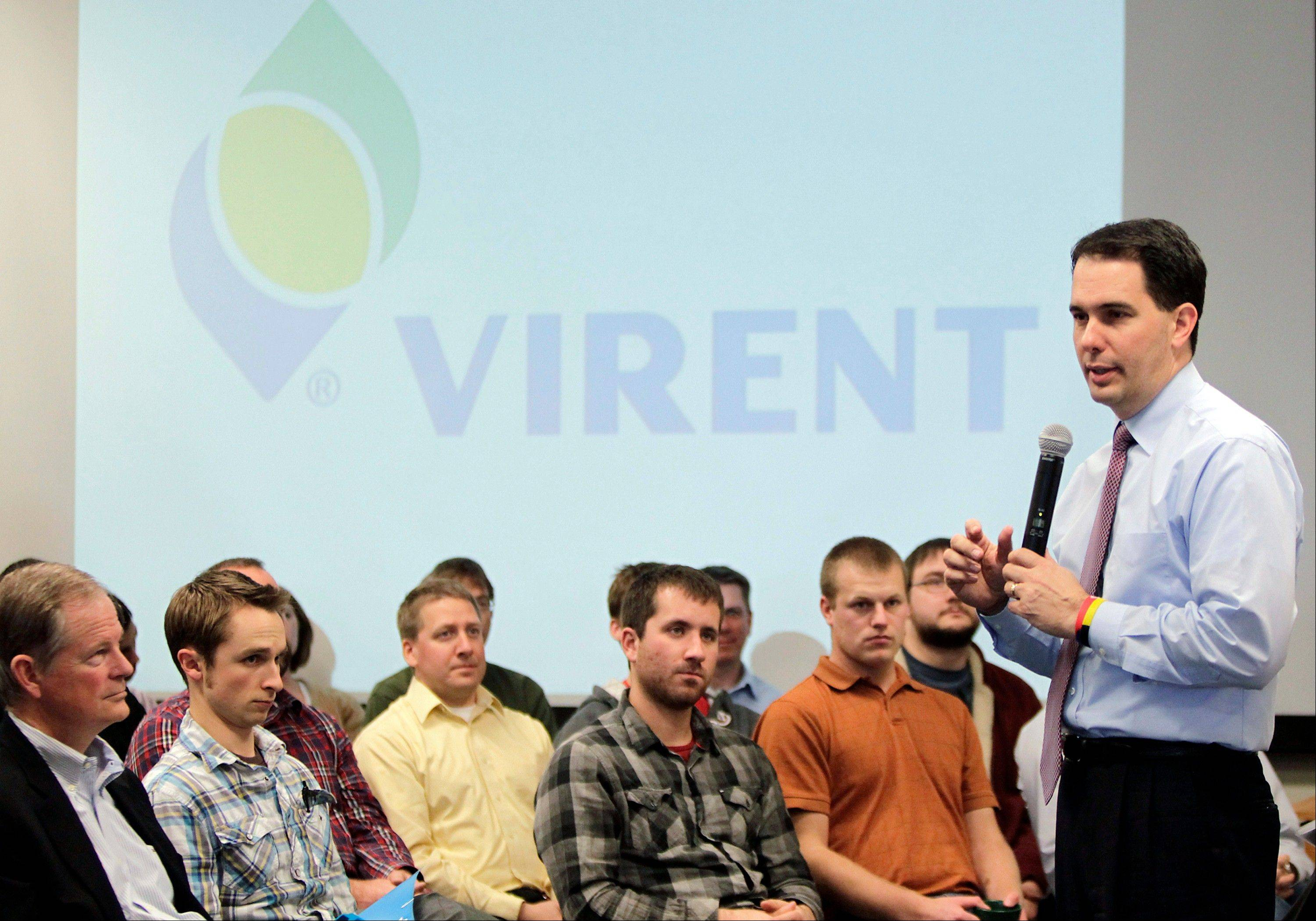Wisconsin Gov. Scott Walker talks Virent workers at a Talk With Walker event in Madison, Wis. Walker became a conservative darling when, as a new Republican governor, he waged a high-profile battle to break the power of public employee unions in his traditionally pro-labor state.