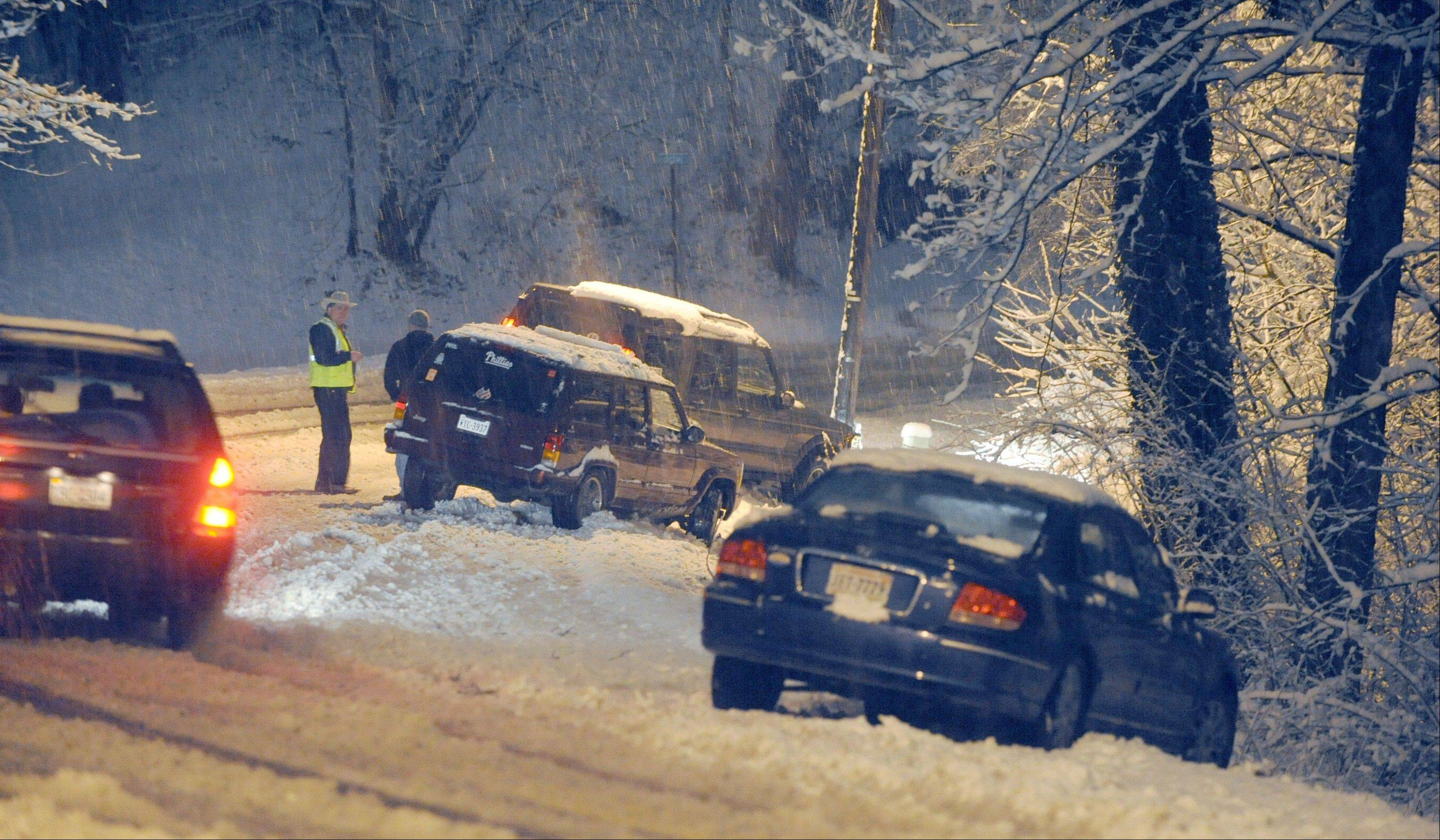 Motorists slide off the road along Garst Mill Road in Roanoke County, Va. during a snowstorm on Thursday, Jan. 17, 2013. Icy roads remain a concern Friday morning and some school systems decided to open late.