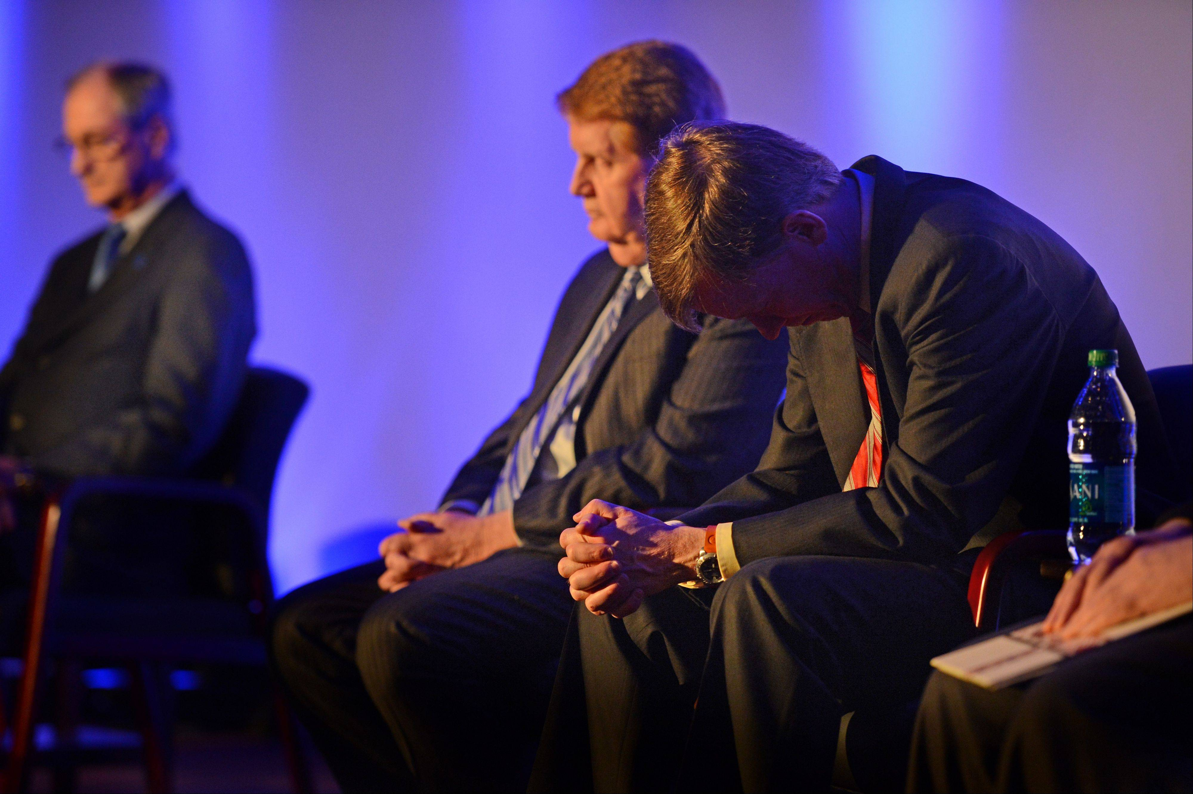 Colorado Gov. John Hickenlooper bows his head during a prayer at the reopening and remembrance ceremony at the Century Aurora cinema, formerly the Century 16, Thursday, Jan. 17, 2013 in Aurora, Colo. The cinema is where 12 people were killed and dozens injured in a shooting rampage last July.