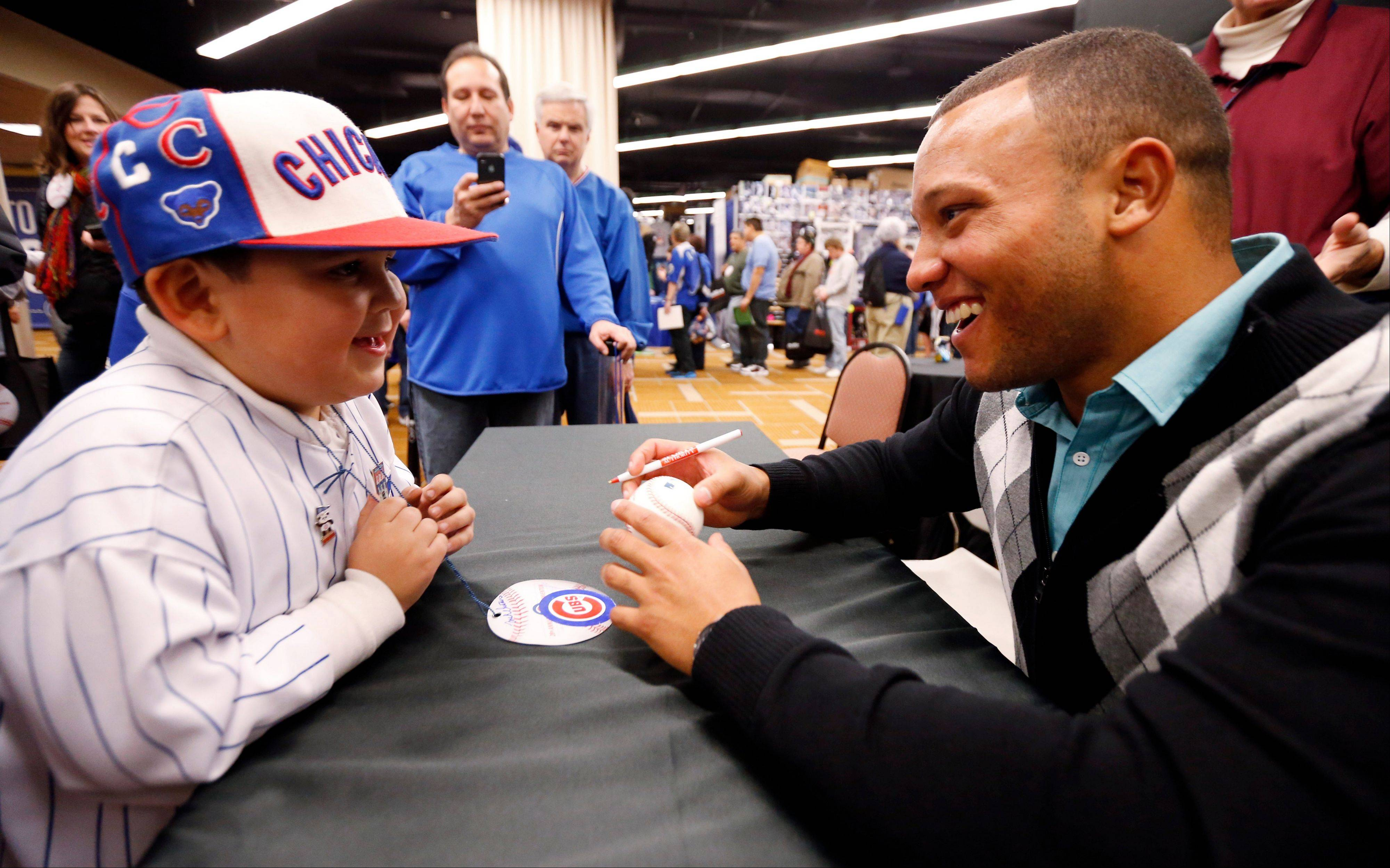 Catcher Welington Castillo talks with Giovani Rocha, 6, during the Cubs Convention on Friday.