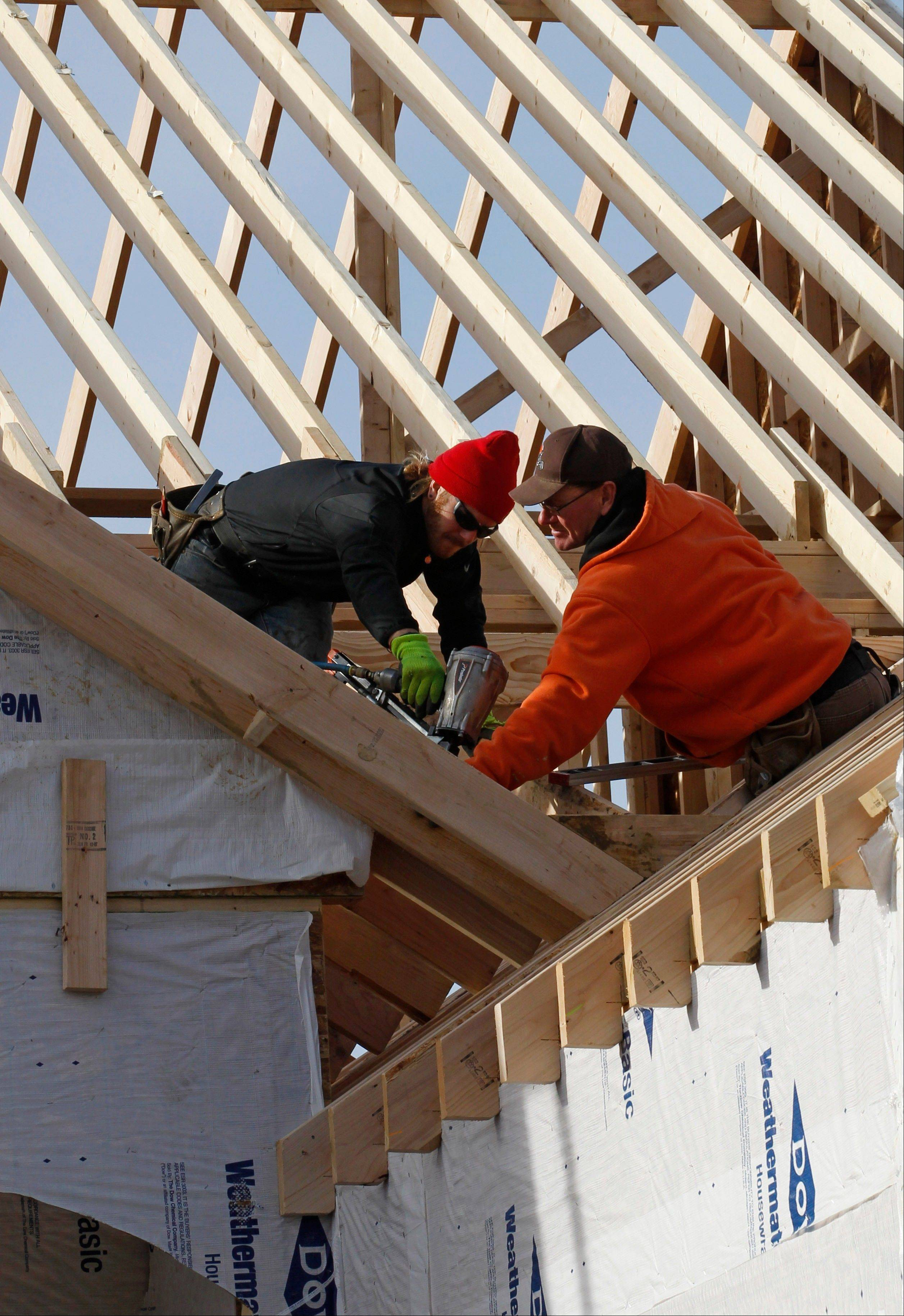 A new home is constructed in Pepper Pike, Ohio. US home construction surges 12.1 percent in December to end best year since 2008.