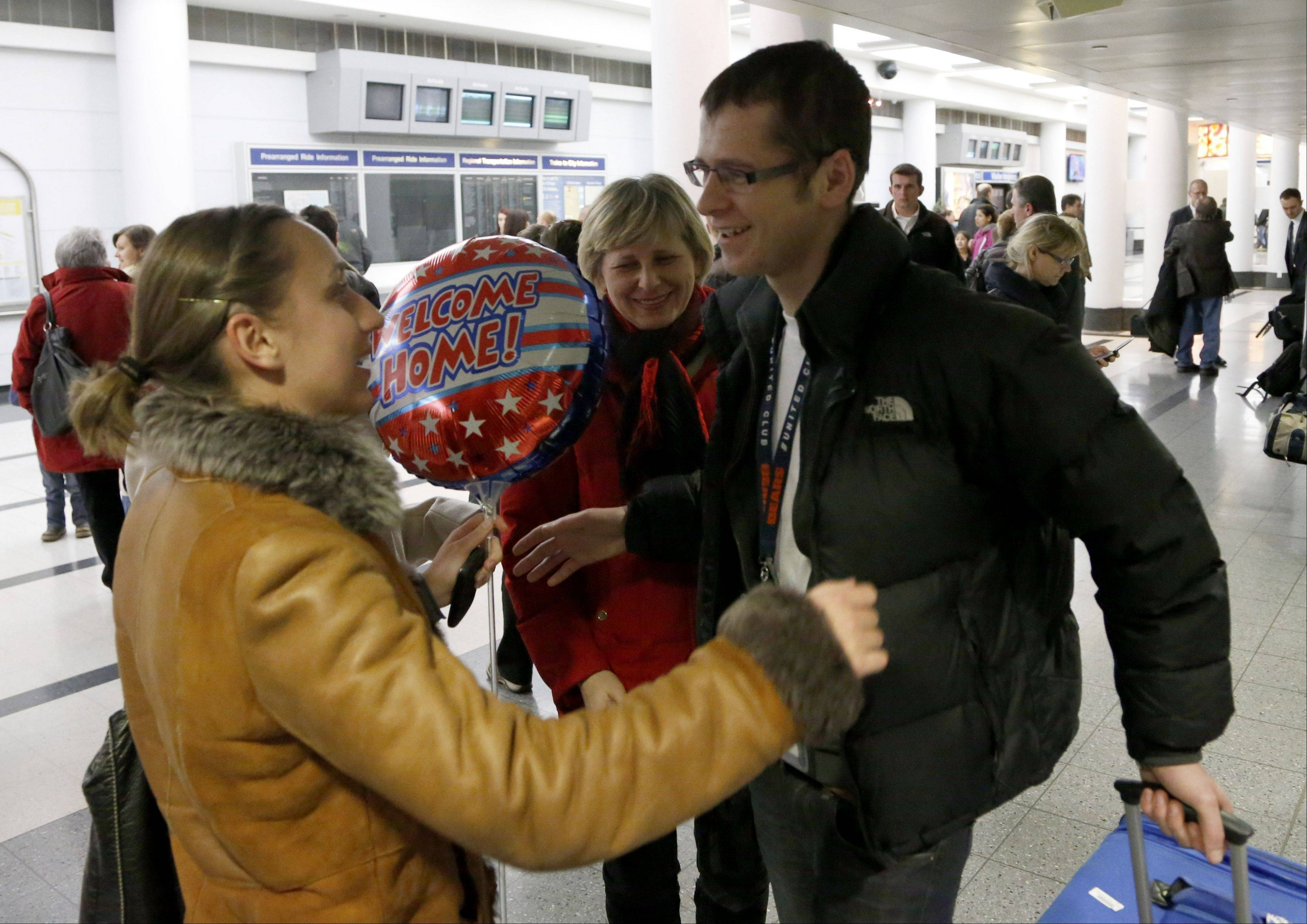 Alla Dziuma, left greets her brother Taras Dukyn after he arrived on Polish Airlines flight 003 from Warsaw, a Boeing 787, after their arrival at O'Hare International Airport.