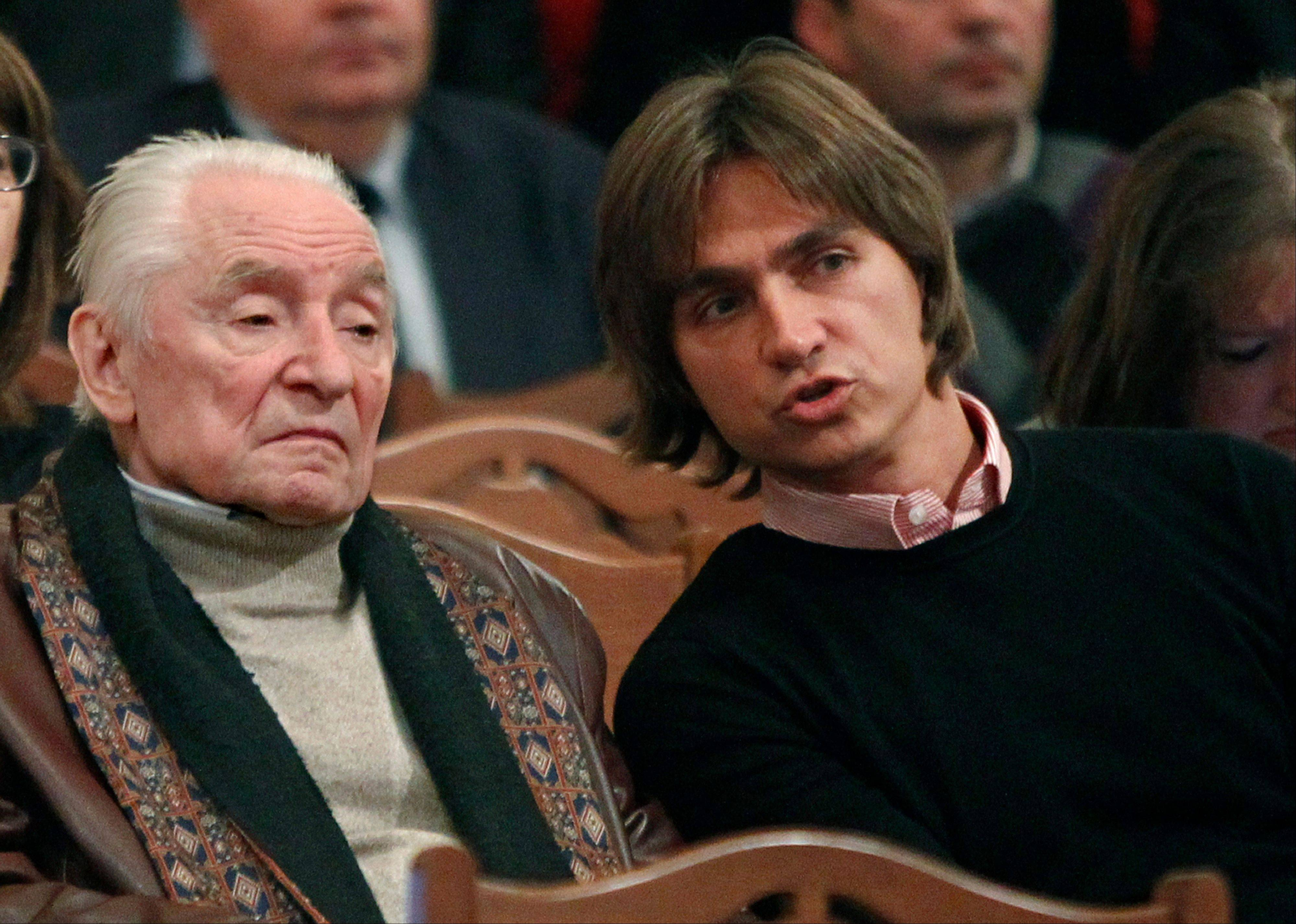 Moscow police said Friday, Jan. 18, 2013, that Sergei Filin, right, an artistic director at the legendary Bolshoi Theater, was attacked Thursday night by a man who splashed acid onto his face as the 43-year-old former dancer came out of his car outside his home in central Moscow.