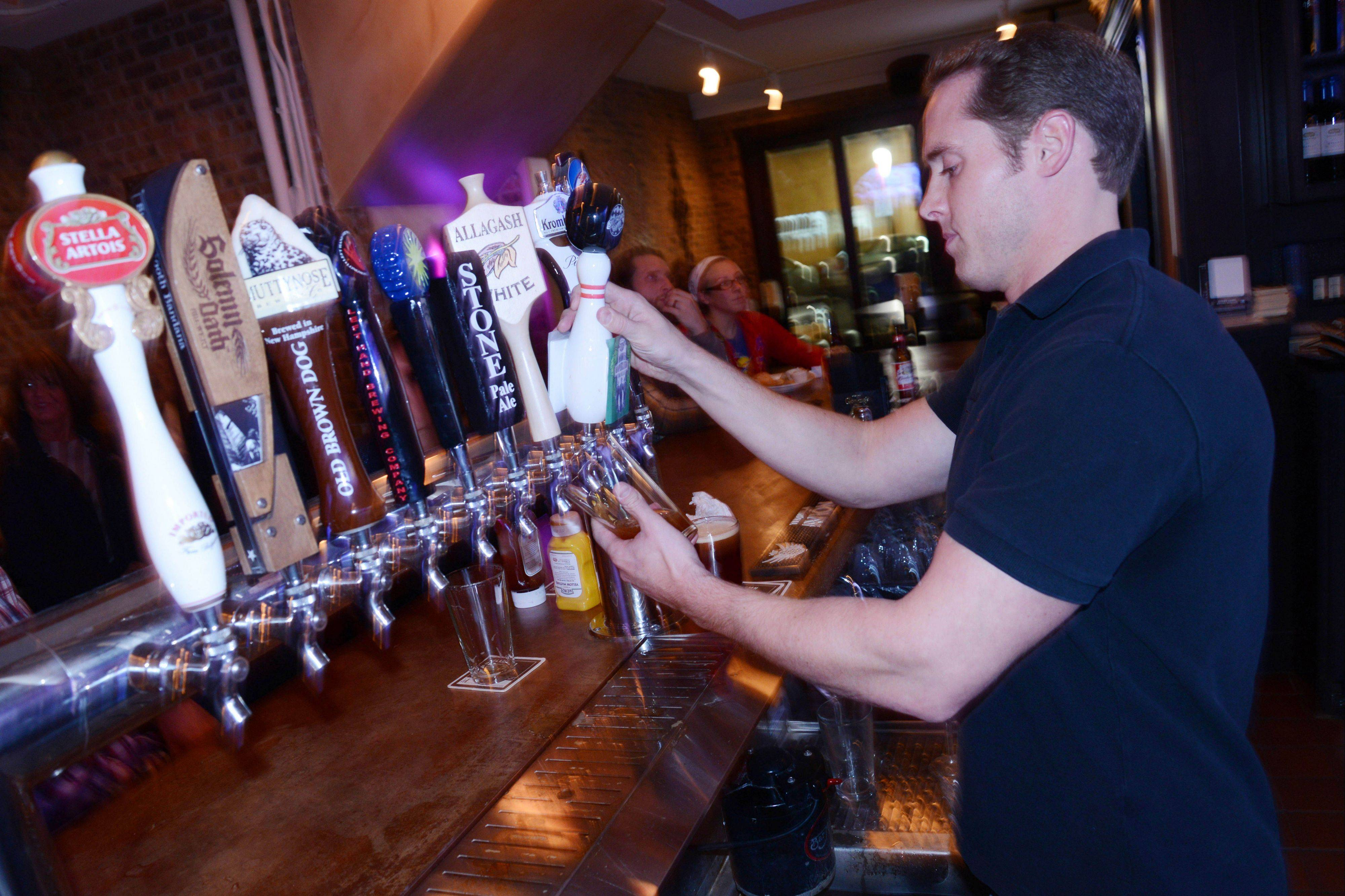 Owner Kevin Hahn taps a beer at Jackson Ave. Pub.