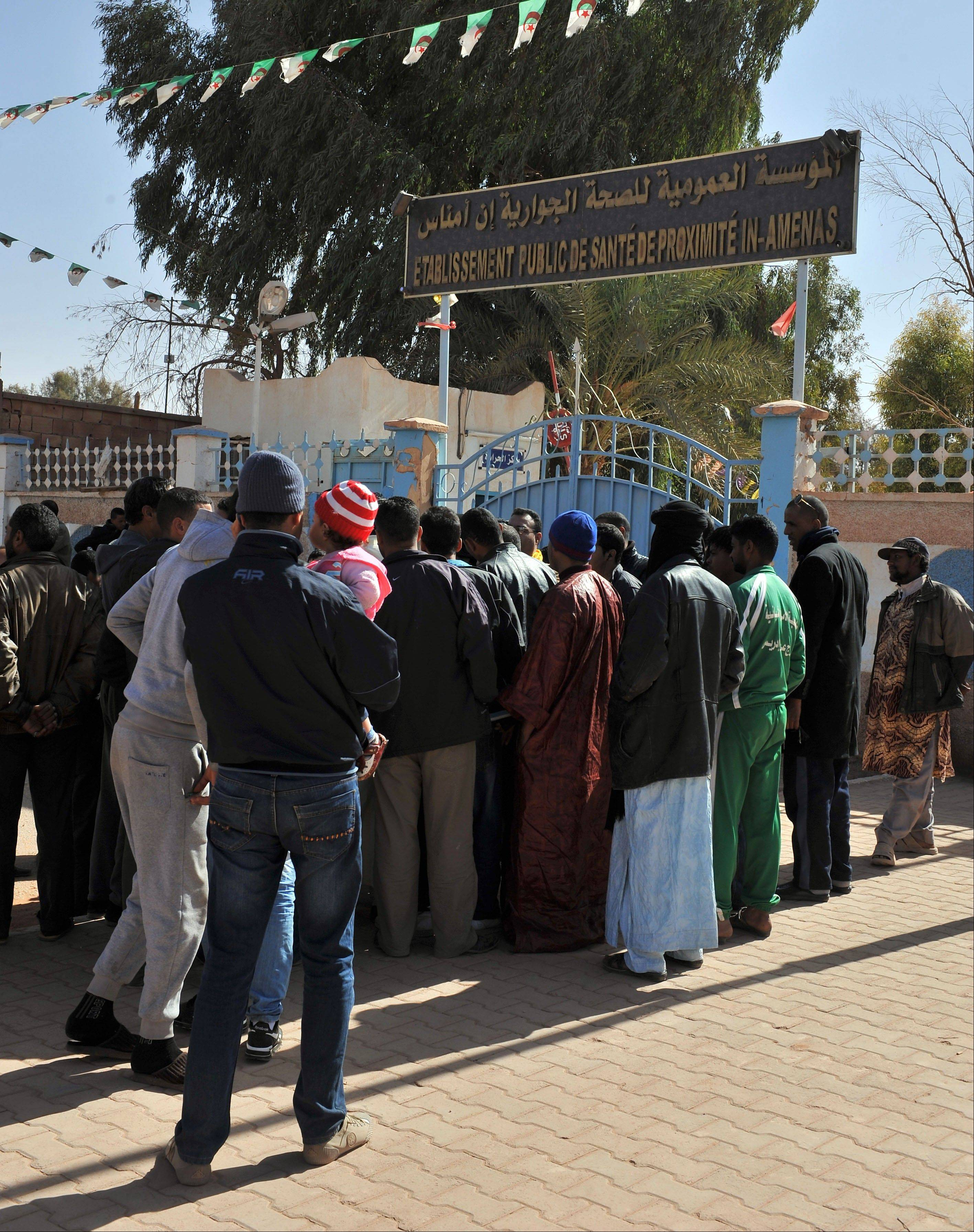 Residents of Ain Amenas, Algeria, gather Friday outside the hospital trying to get information concerning relatives wounded during the terrorist attack at the gas plant.
