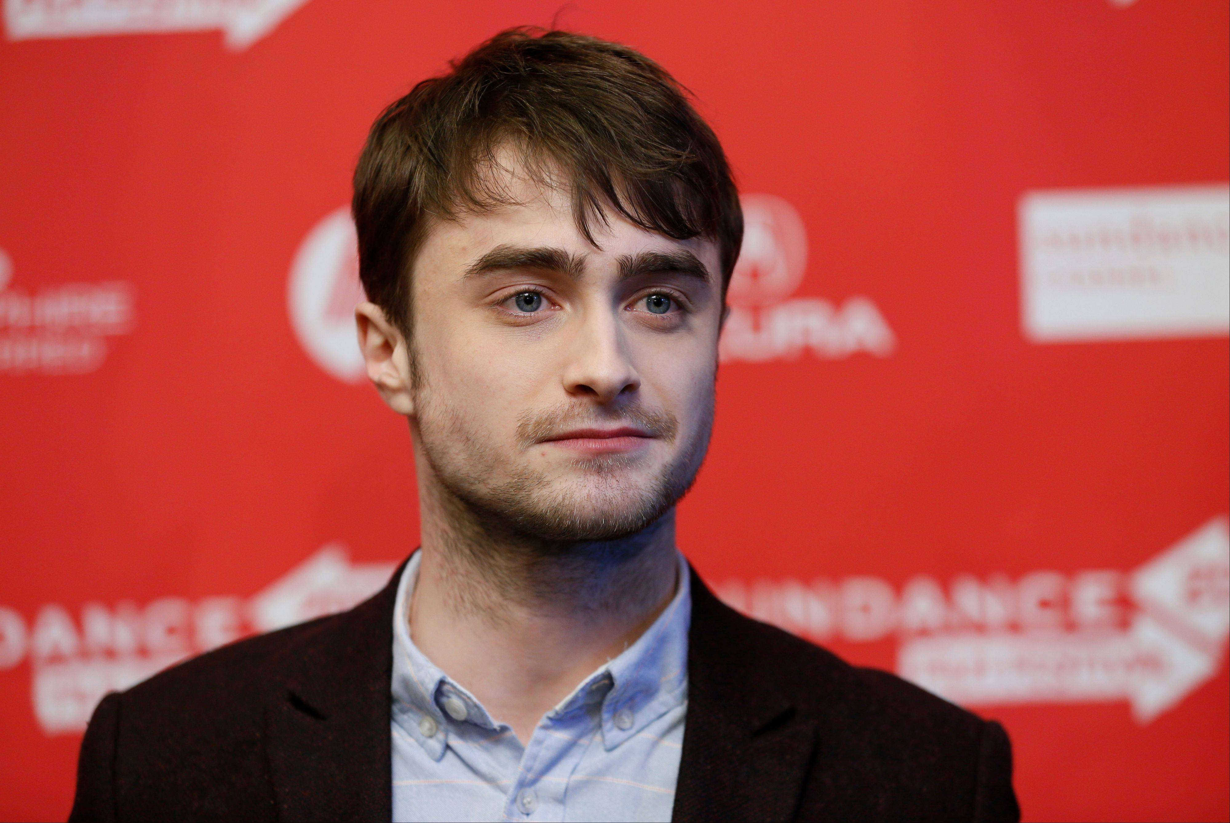 "Actor Daniel Radcliffe poses at the premiere of ""Kill Your Darlings"" during the 2013 Sundance Film Festival on Friday."