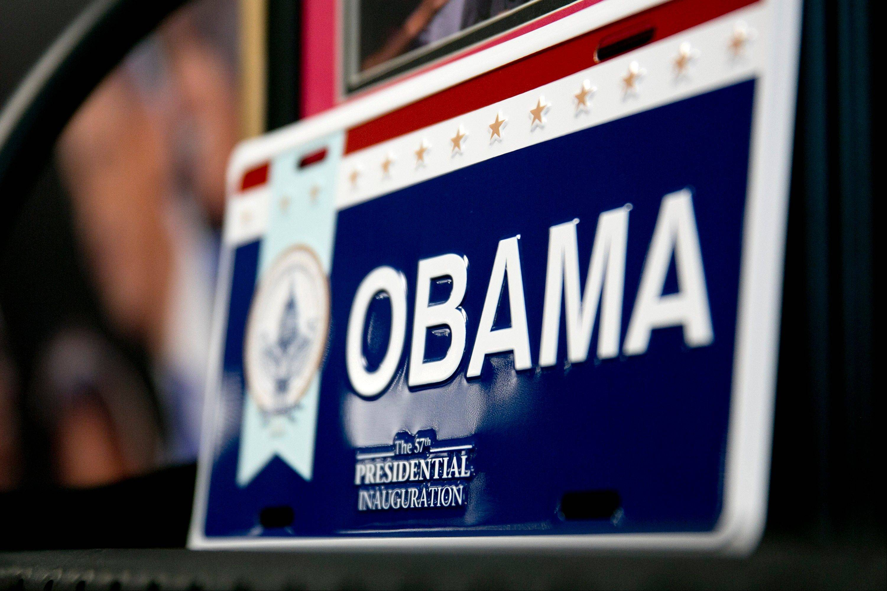 A President Barack Obama license plate sits on display for sale Friday at the Presidential Inaugural Committee store in Washington, D.C..