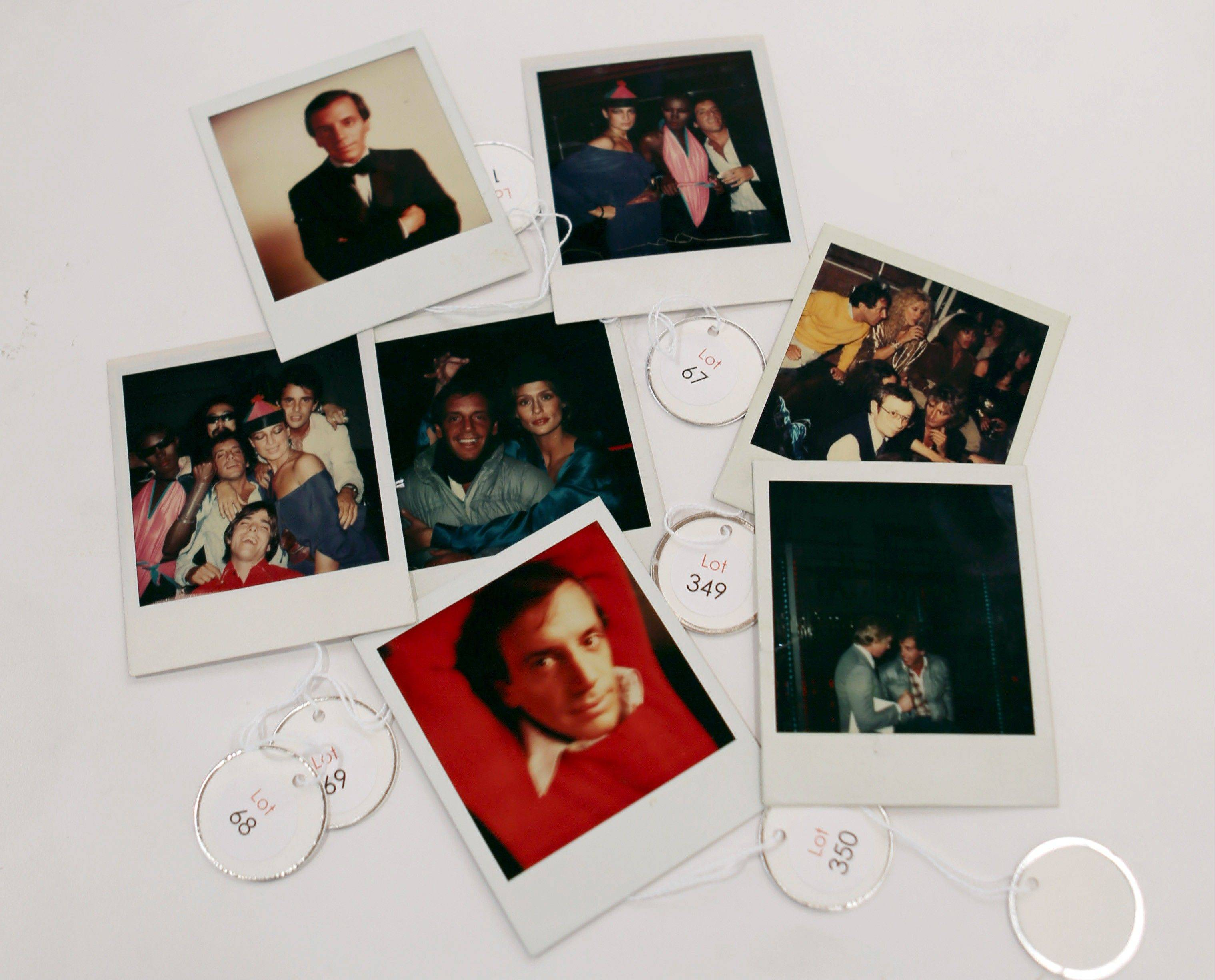 Various polaroids shot by Andy Warhol at Studio 54 are on display Wednesday in West Palm Beach, Fla.
