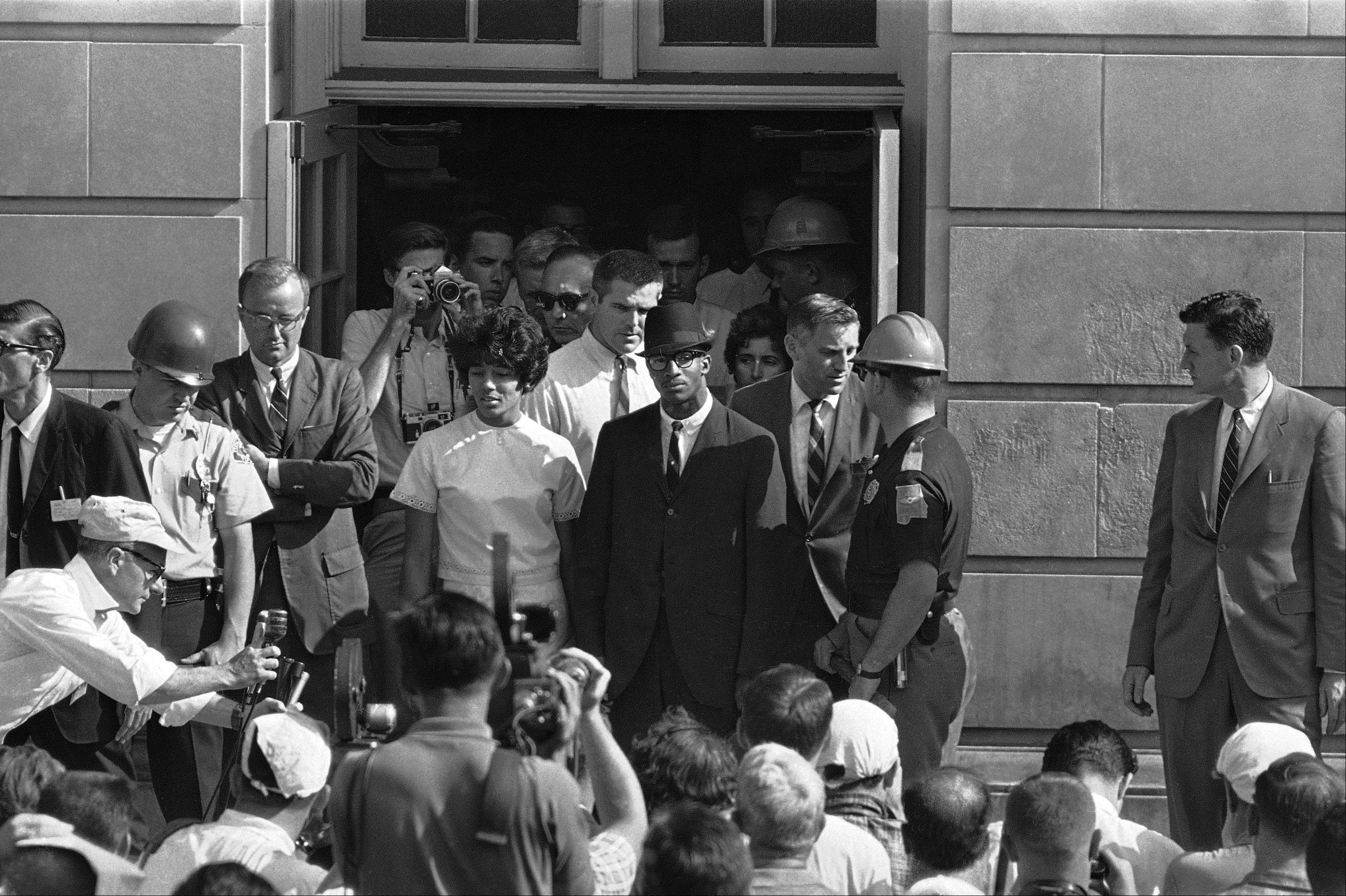 "Associated Press/June 11, 1963 Vivian Malone and James Hood stand in the doorway of Foster Auditorium where they hold what they called their ""first and final news conference"" after the two African-American students registered at the University of Alabama at Tuscaloosa, Ala."