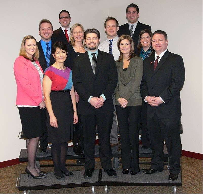 The newest National Board Certified teachers in Palatine-Schaumburg Township District 211 are in the bottom row from left Angela Drenth, Gina Hubbard, Brian Drenth, Kimberly Selleck, Eric Hauser, and in the top row from left Christopher Grattoni, Jordan Catapano, Tanya Katovich, Brian Curtin, Derek Schmidt, and Tracy Serafini.