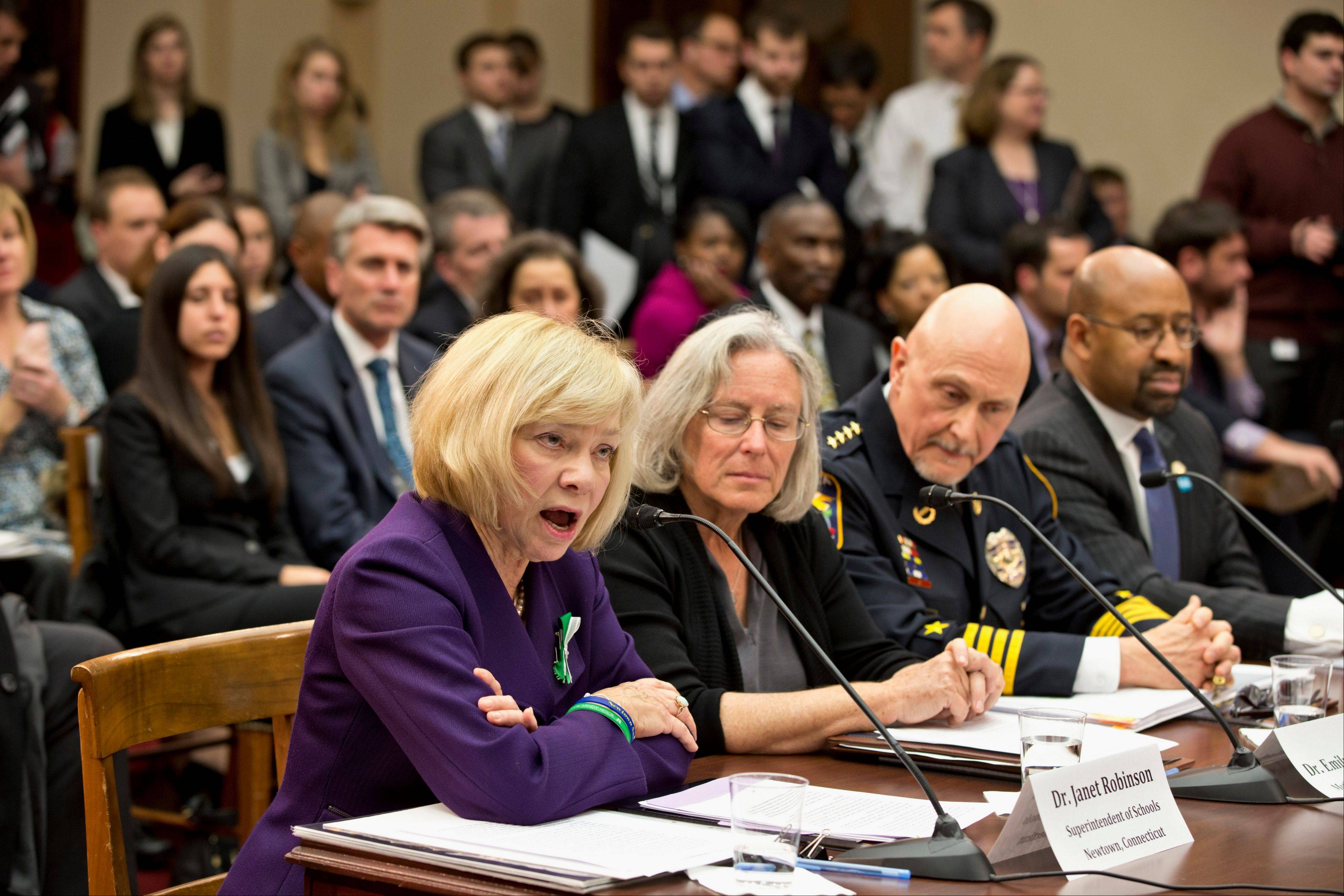 Newtown, Conn. School Superintendent Janet Robinson, left, testifies Wednesday on Capitol Hill in Washington before a special hearing on gun violence.