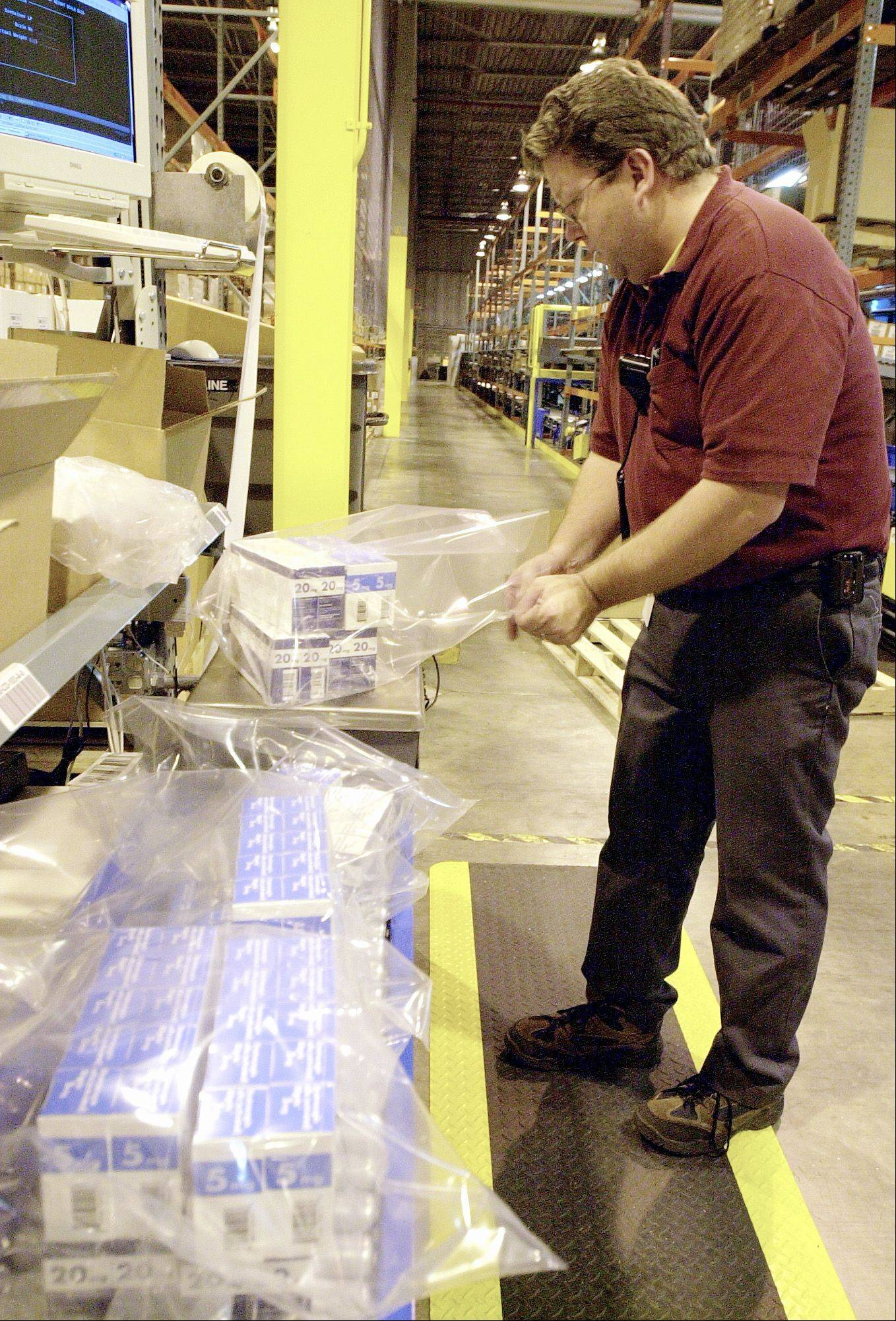 An Eli Lilly and Co. employee packages a drug at the Lilly USA facility in Indianapolis.