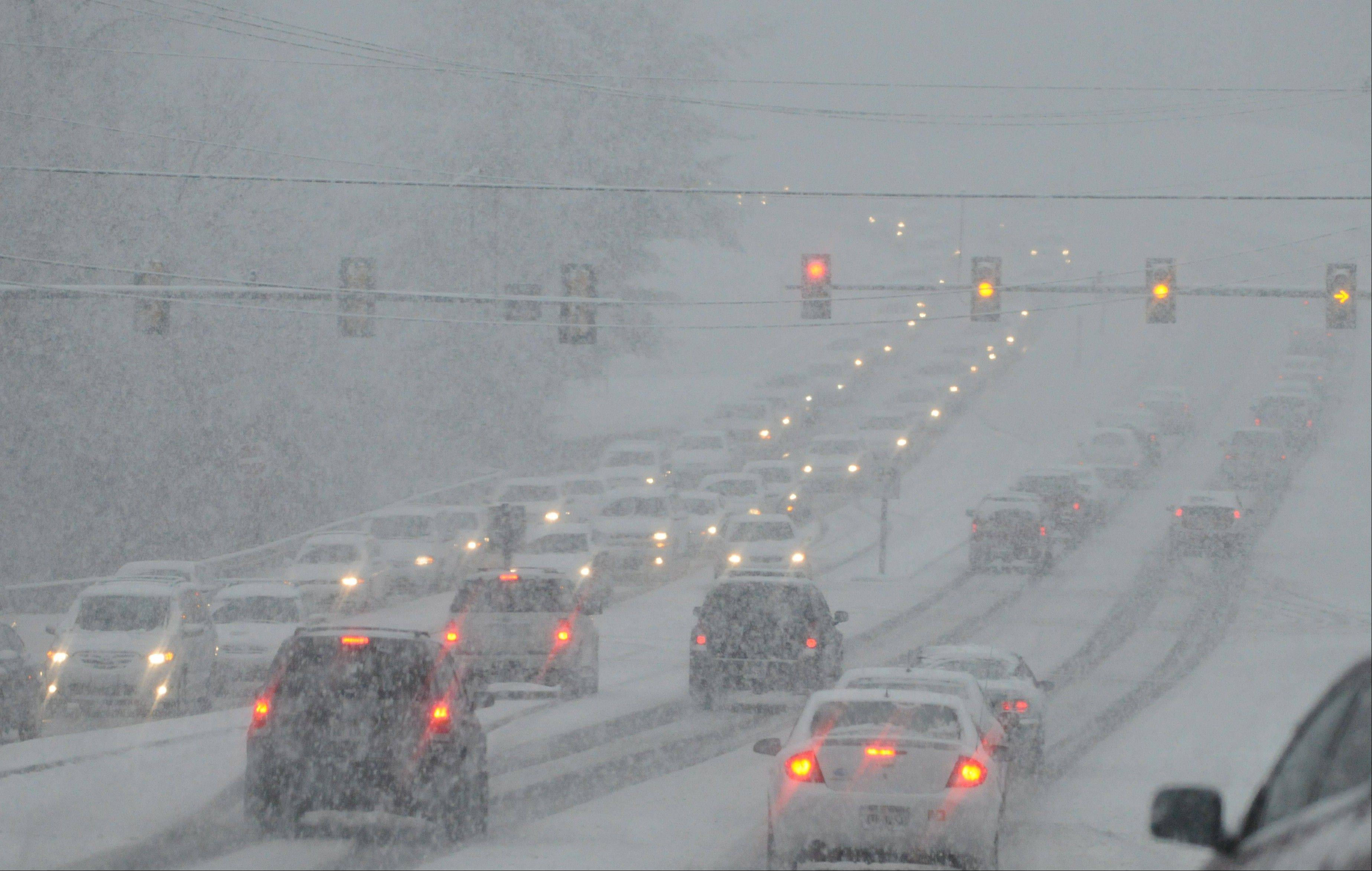 Commuters on 419 drive through heavy snowfall and low visibility on Thursday, Jan. 17, 2013 in Roanoke County, Va. Icy roads remain a concern Friday morning and some school systems decided to open late.