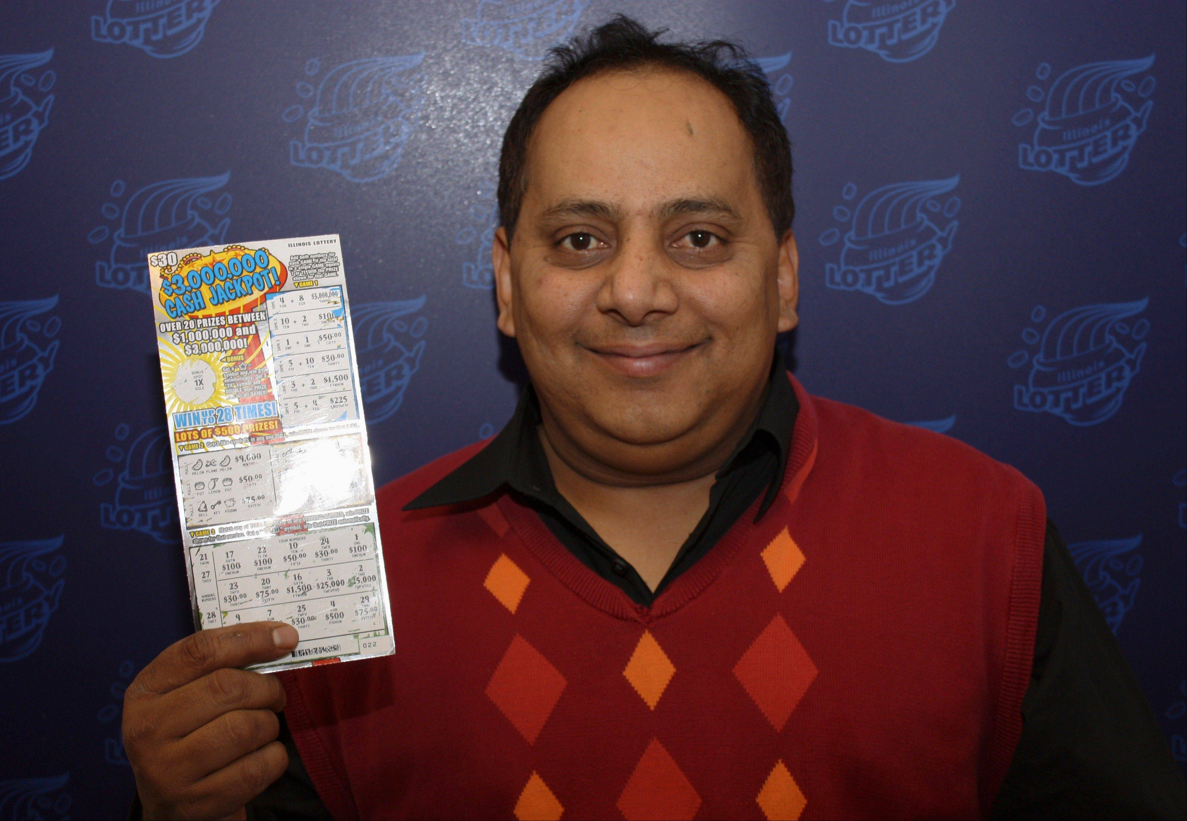 Urooj Khan, 46, of Chicago, poses with a winning lottery ticket. Khan died from cyanide poisoning in July shortly before collecting $425,000 in winnings.