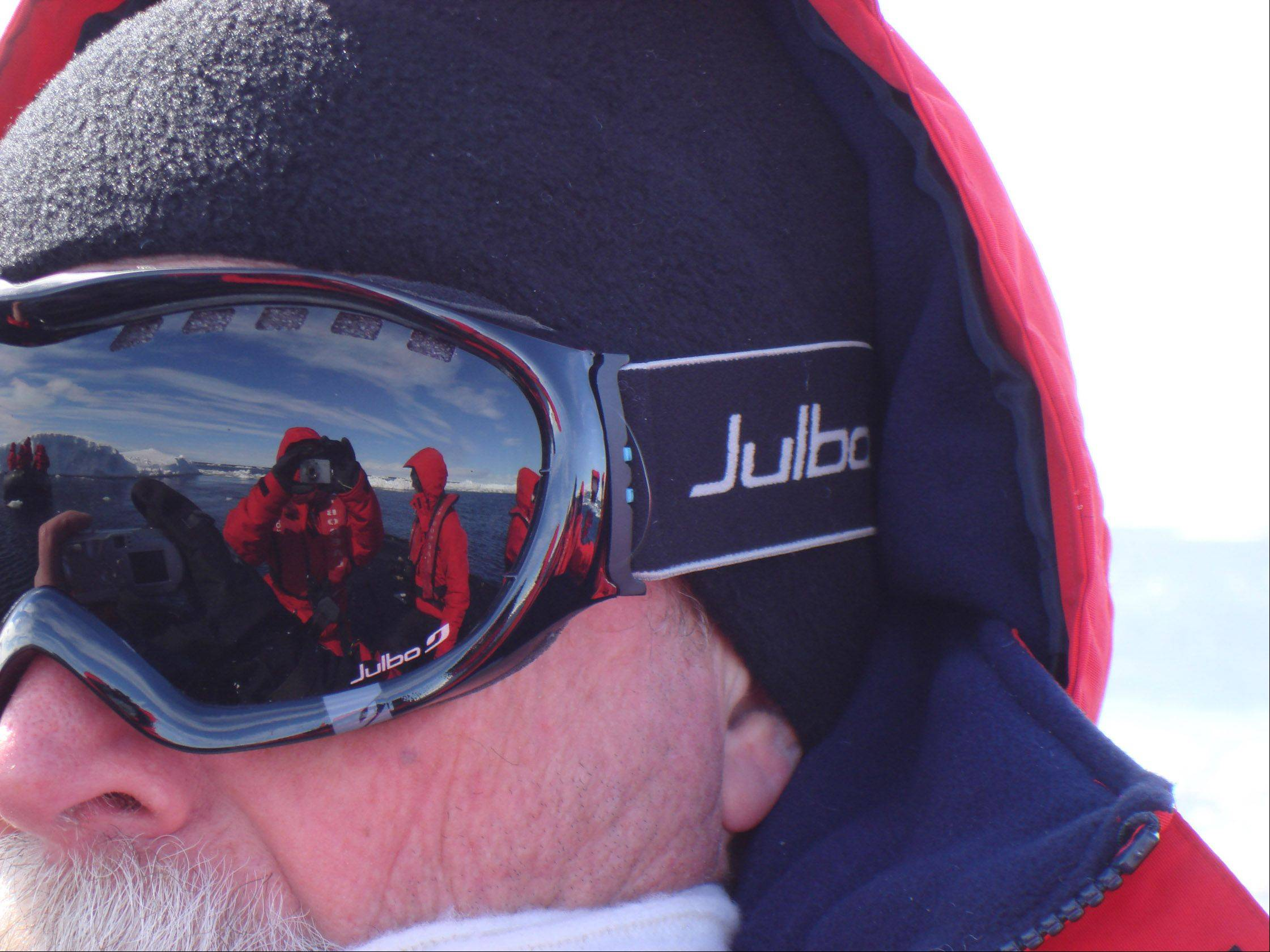 David Robison, of Buffalo Grove, gazes out over the Antarctic Sound, reflected in his protective goggles is a vision of clear skies, pack ice and his wife Judie, the photographer, on the Antarctic Peninsula last month.
