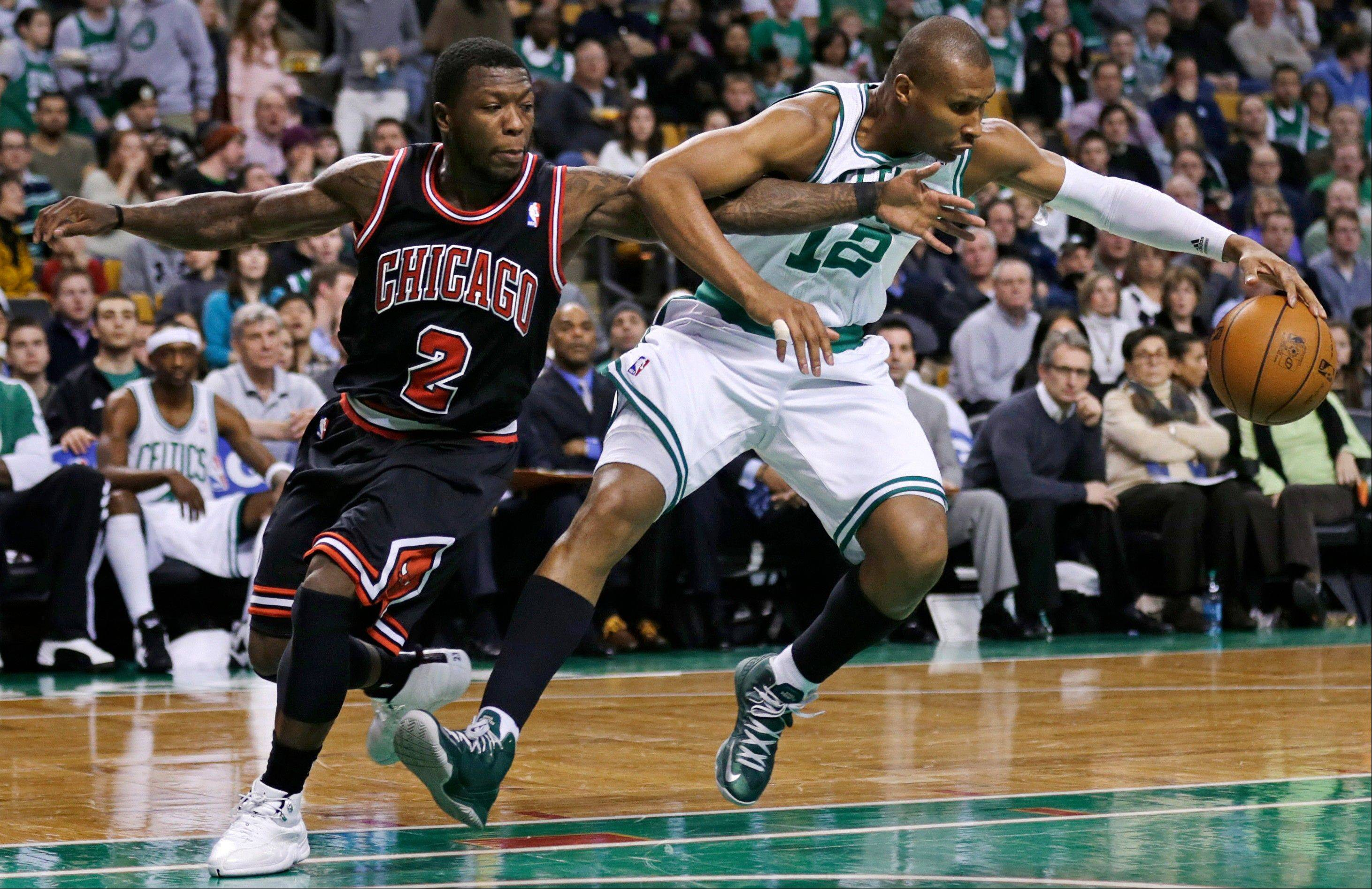 Boston Celtics guard Leandro Barbosa, right, tries to keep control of the ball as he is pressured by Chicago Bulls guard Nate Robinson during the first half Friday in Boston.