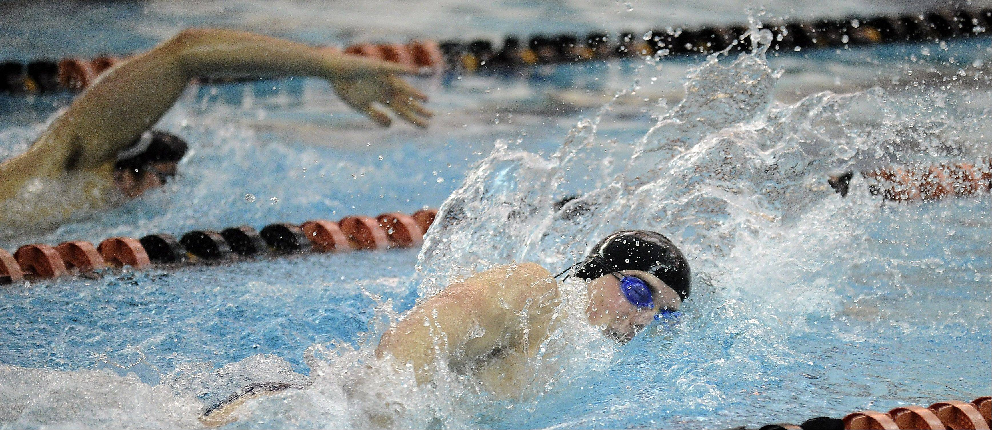 Barrington's Jack Strauss, top, and Conant's Jonathon Burke go neck and neck in the 200-yard freestyle with Burke pulling ahead for the win at Barrington on Friday.