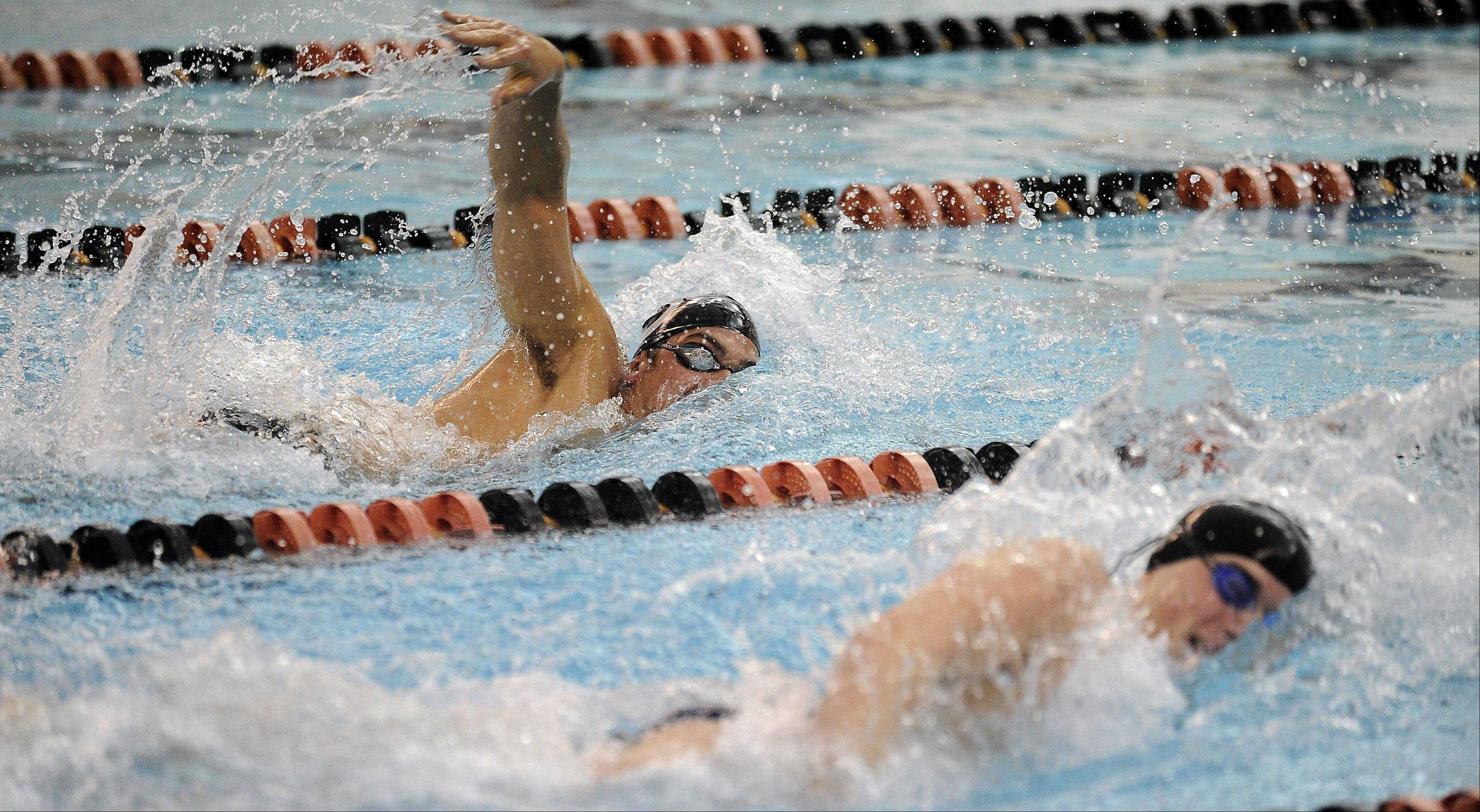 Barrington's Jack Strauss, top, and Conant's Jonathon Burke go neck and neck in the 200 freestyle, with Burke pulling out a close win at Barrington on Friday.