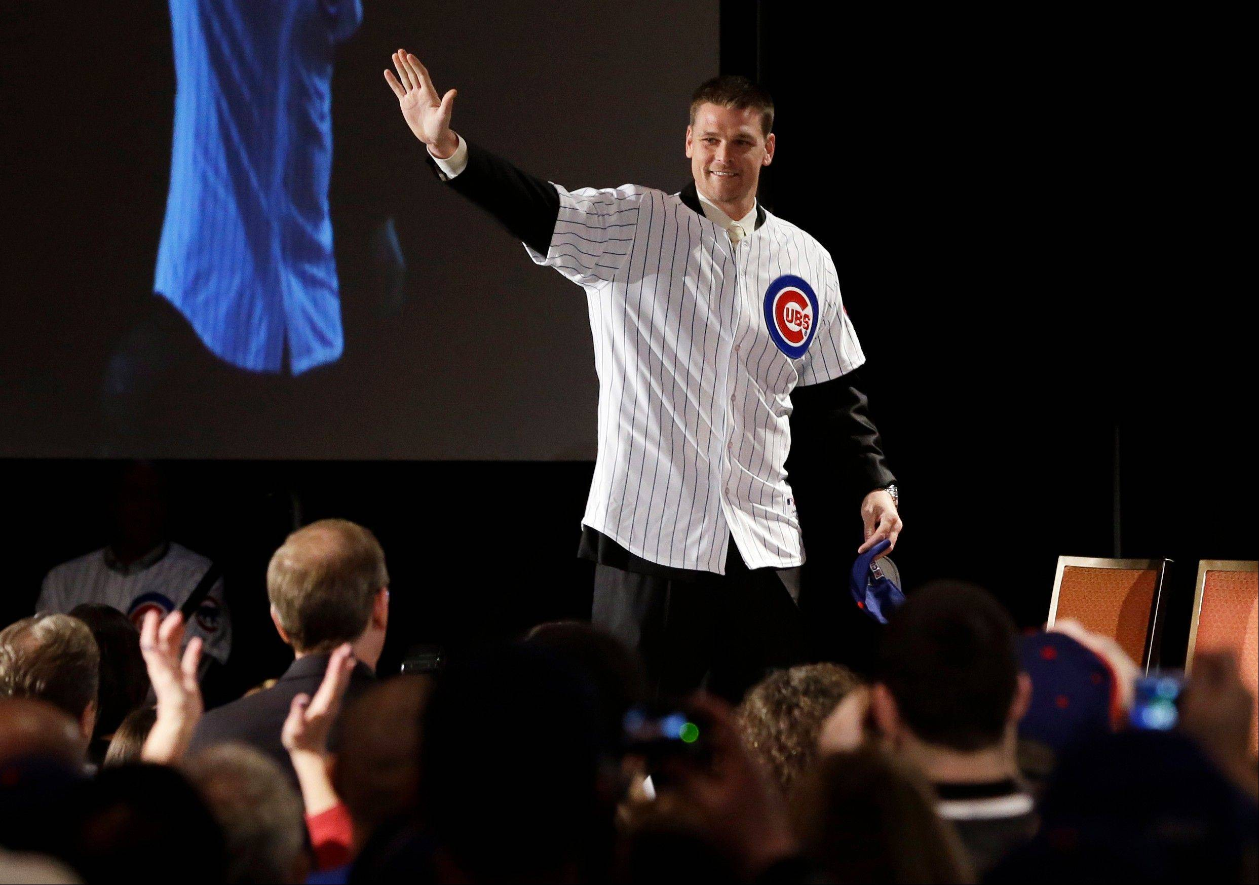 Former Cubs pitcher Kerry Wood waves to fans during the Cubs Convention Friday in Chicago.