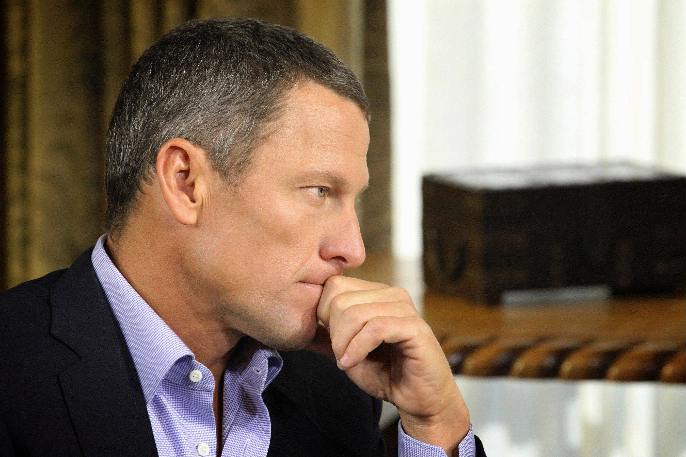 "Cyclist Lance Armstrong listens to a question from Oprah Winfrey during taping for the show ""Oprah and Lance Armstrong: The Worldwide Exclusive"" in Austin, Texas. Armstrong talked about talking to his children about his doping in part 2 of the interview aired Friday."