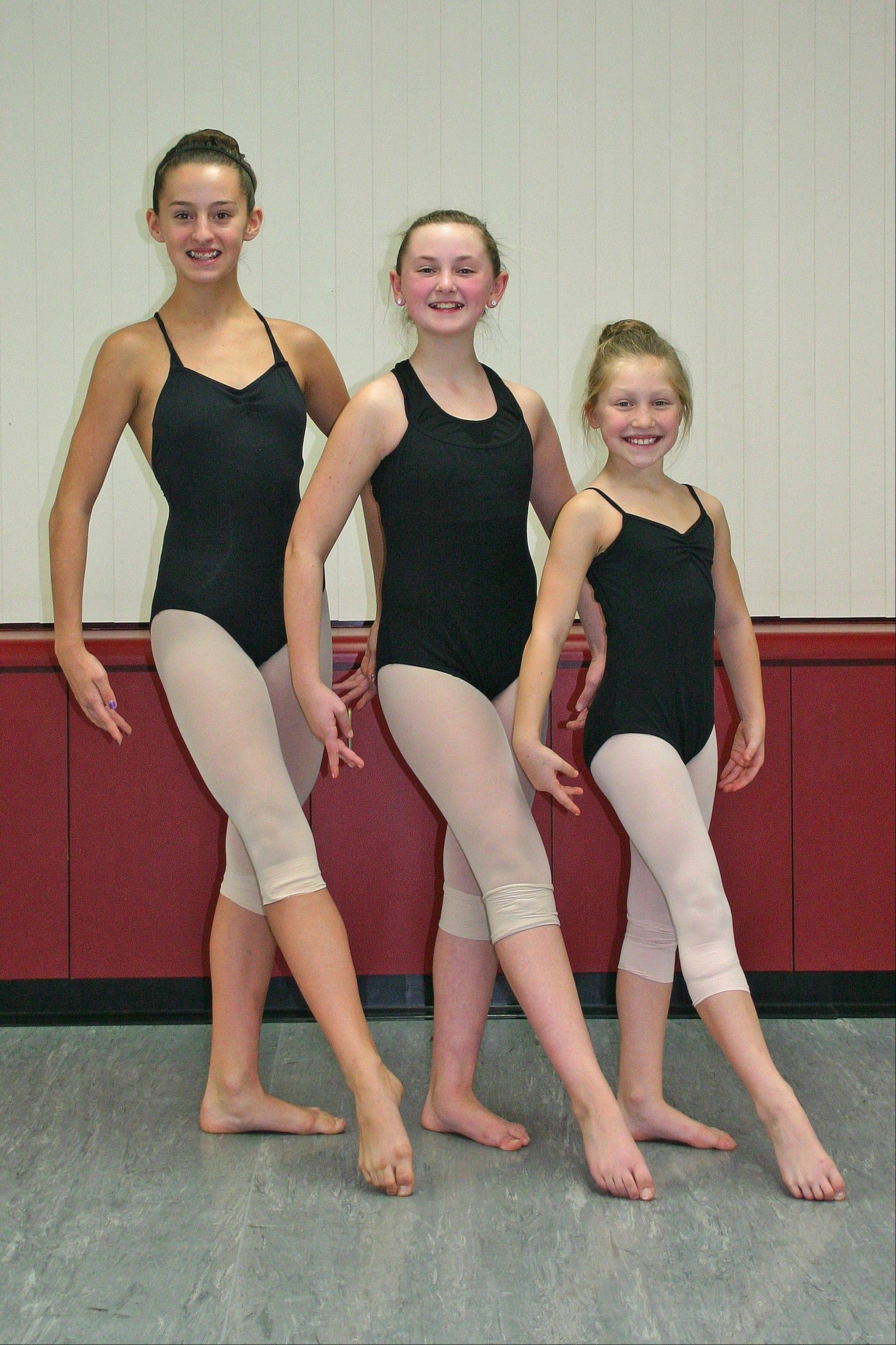 From left, Meghan Hanrahan, Kim Fairhead, and Jordin Suwalski, representing Artistry in Motion, won top awards at the November 9-11, 24Seven Dance Competition.
