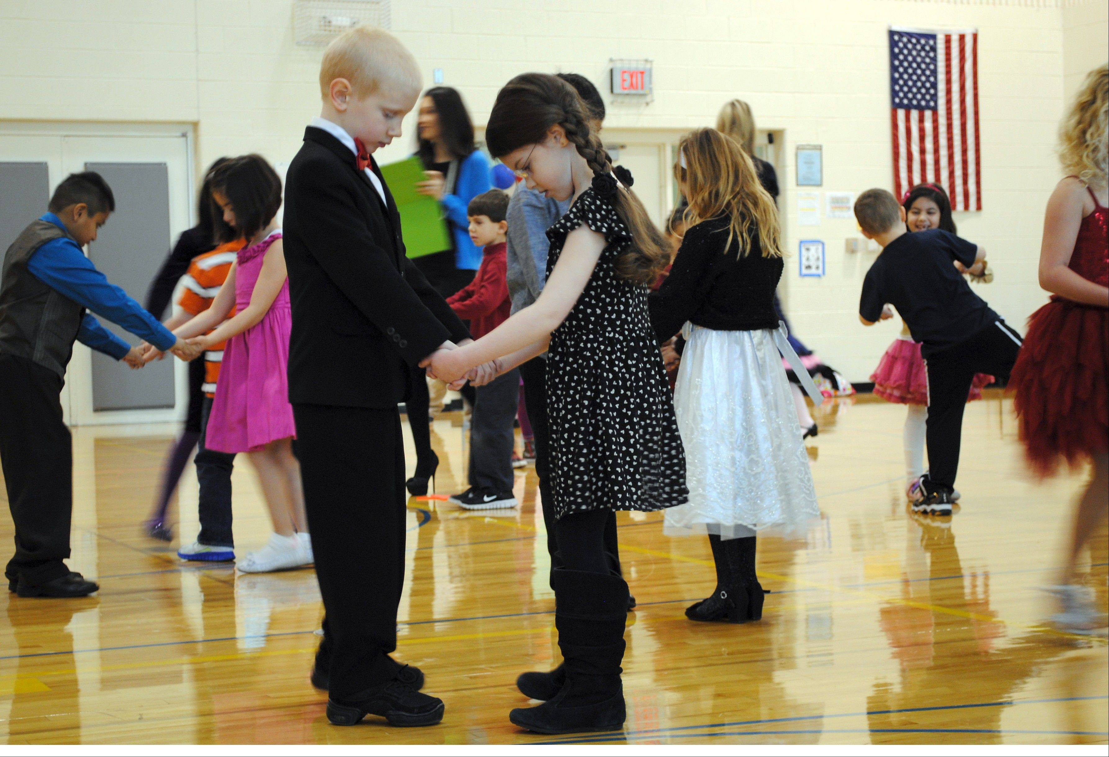 First-graders Kaitlyn Blechman and Zachary Hertzberg explore the mysteries of the box step.