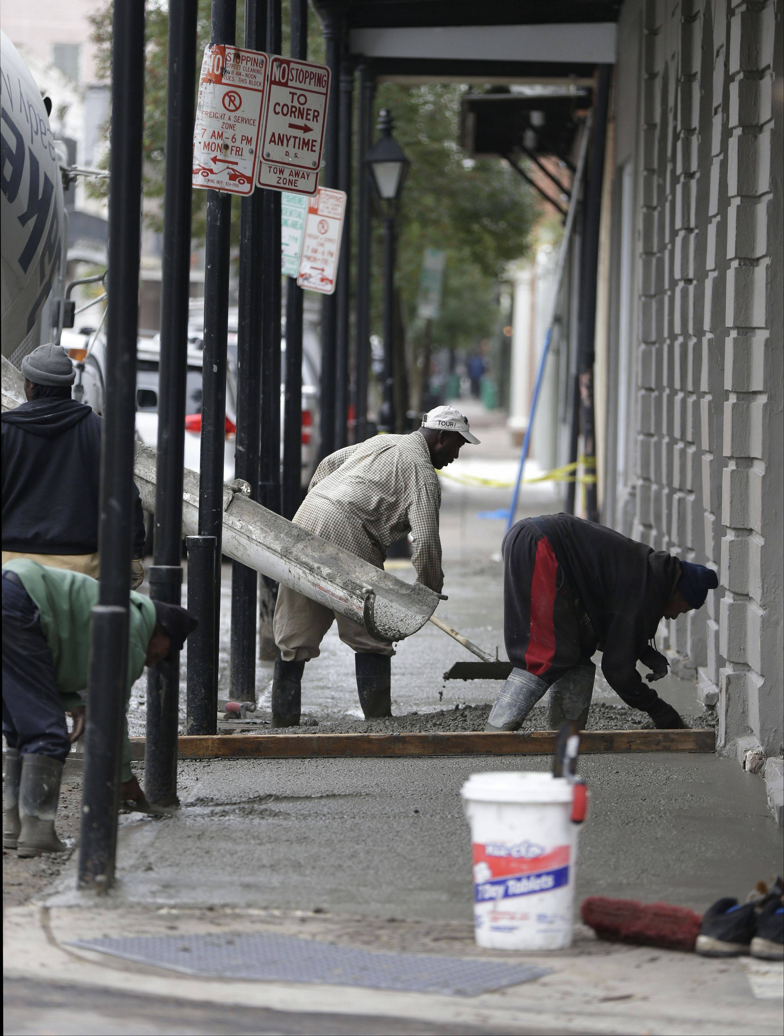 Associated Press Workers pour a new sidewalk Tuesday on Royal Street in the French Quarter section of in New Orleans. With the Super Bowl in New Orleans Feb. 3 and Mardi Gras falling just nine days later, the city is gearing up for a massive celebration.