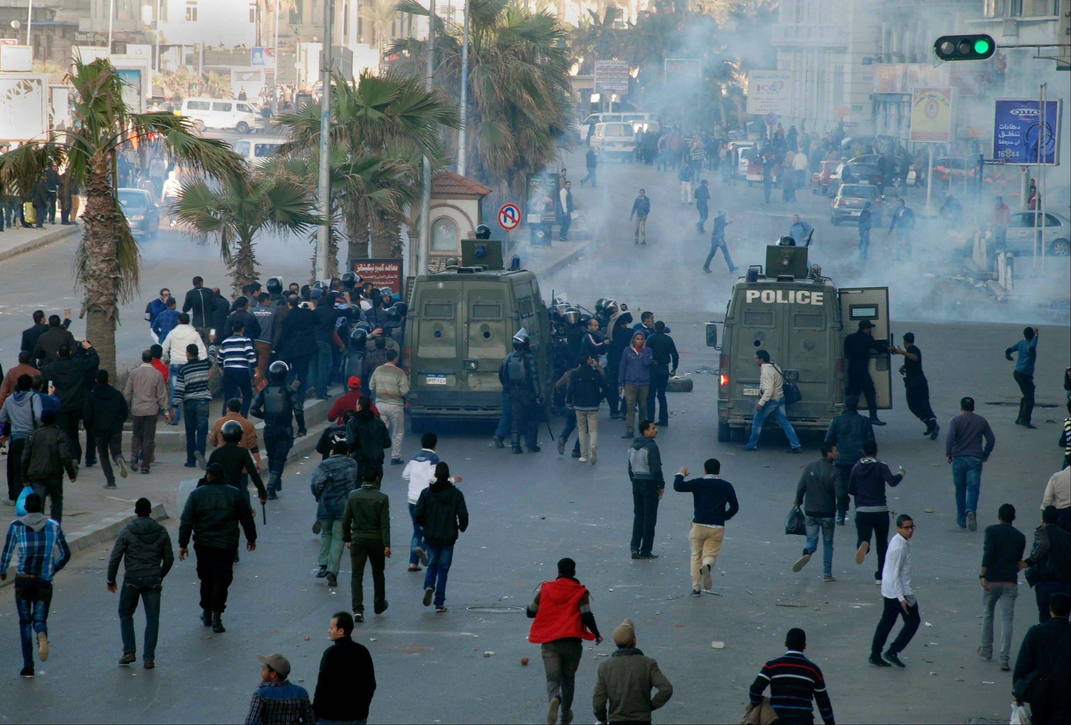Egyptian police and protesters clash outside a courtroom Saturday in Alexandria, Egypt.