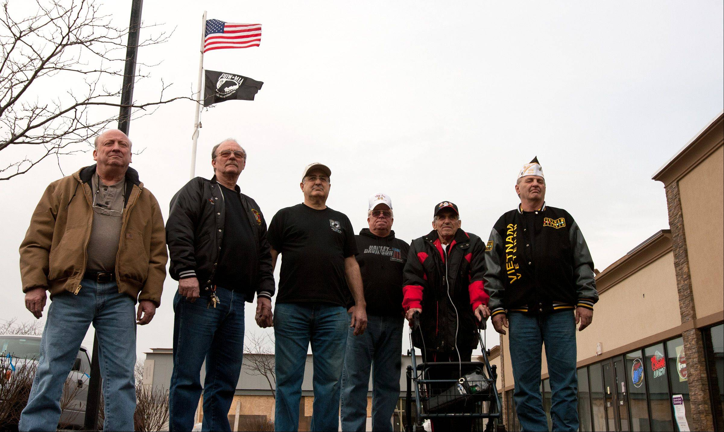 Members of VFW Post 2377, from left, Jimmy Keys, Tim Loome, Maury Deering, Greg Van Meter, Herbert Kalischefski and John Kowalczyk say they will fight orders from the leaseholder to remove the American flag from their Glendale Heights headquarters.