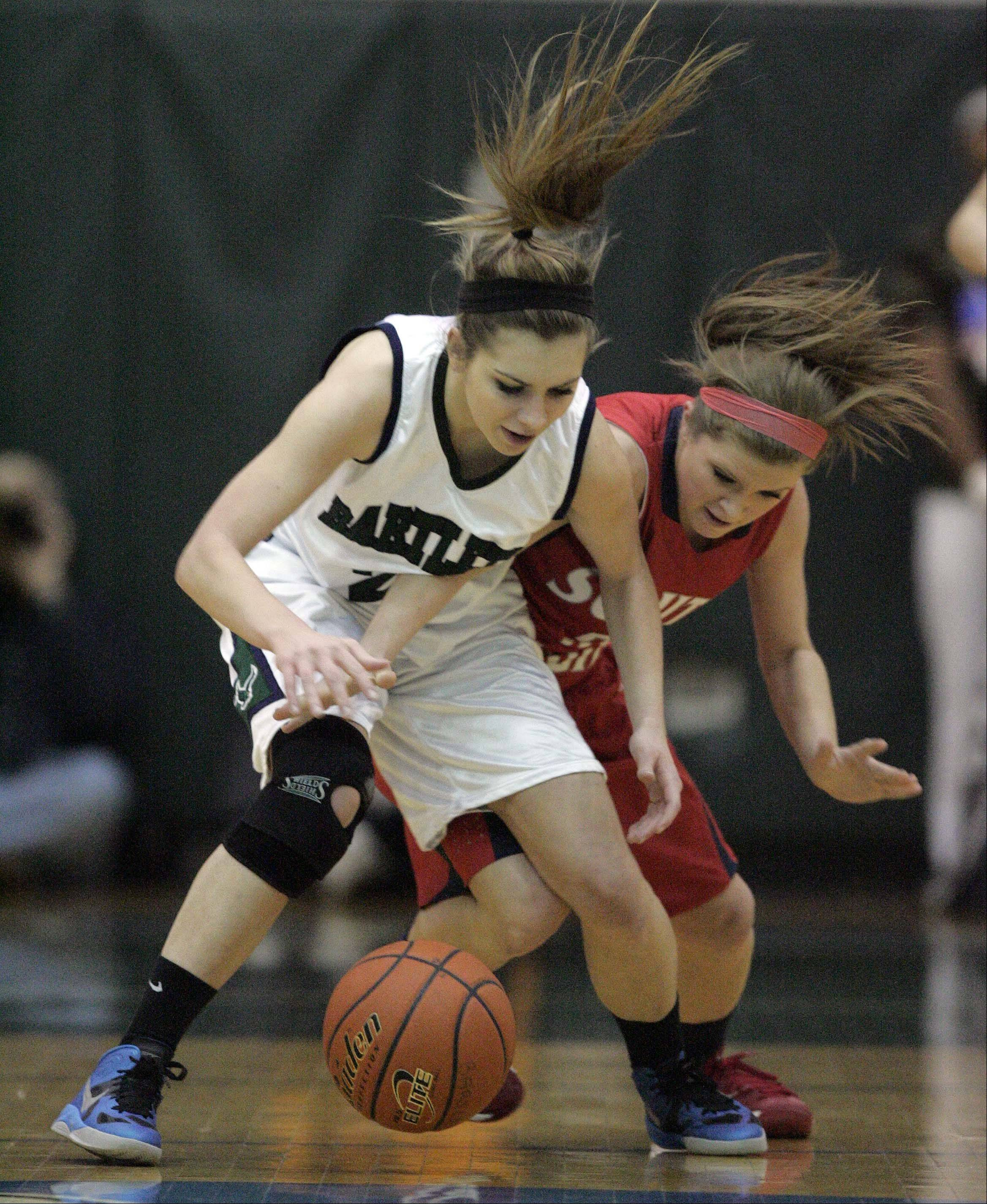 Bartlett�s Chantel Zasada, 21 goes head to head with South Elgin�s Anna Tracy, 5, as they fight for a loose ball during girls basketball at Bartlett Saturday January 19, 2013.