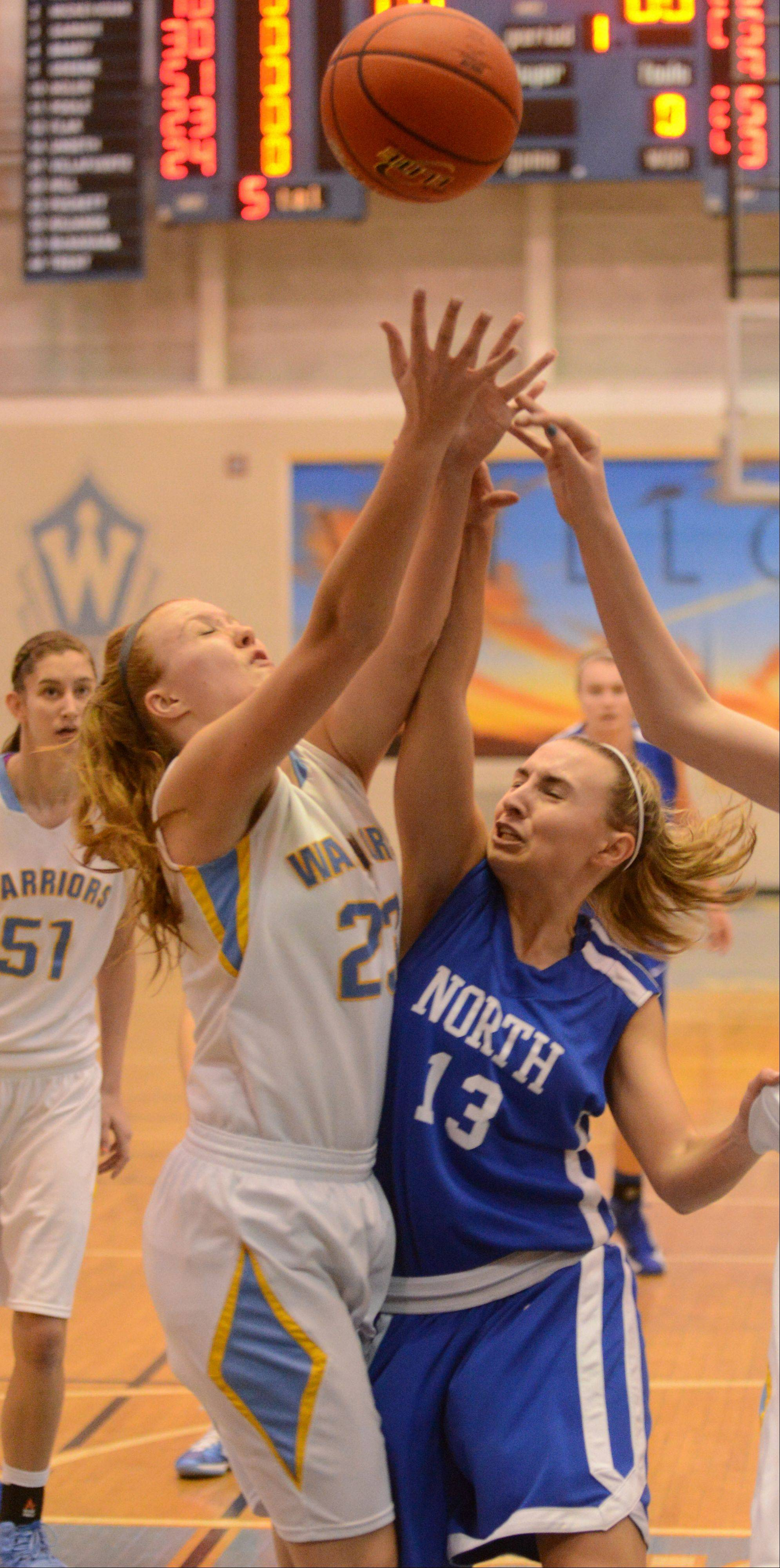 Ashley Collins of Main West,left, and Brooke Schanowski of Wheaton north go for a rebound during the Wheaton North vs. Maine West girls basketball game at McDonald�s Shootout in Willowbrook Saturday.