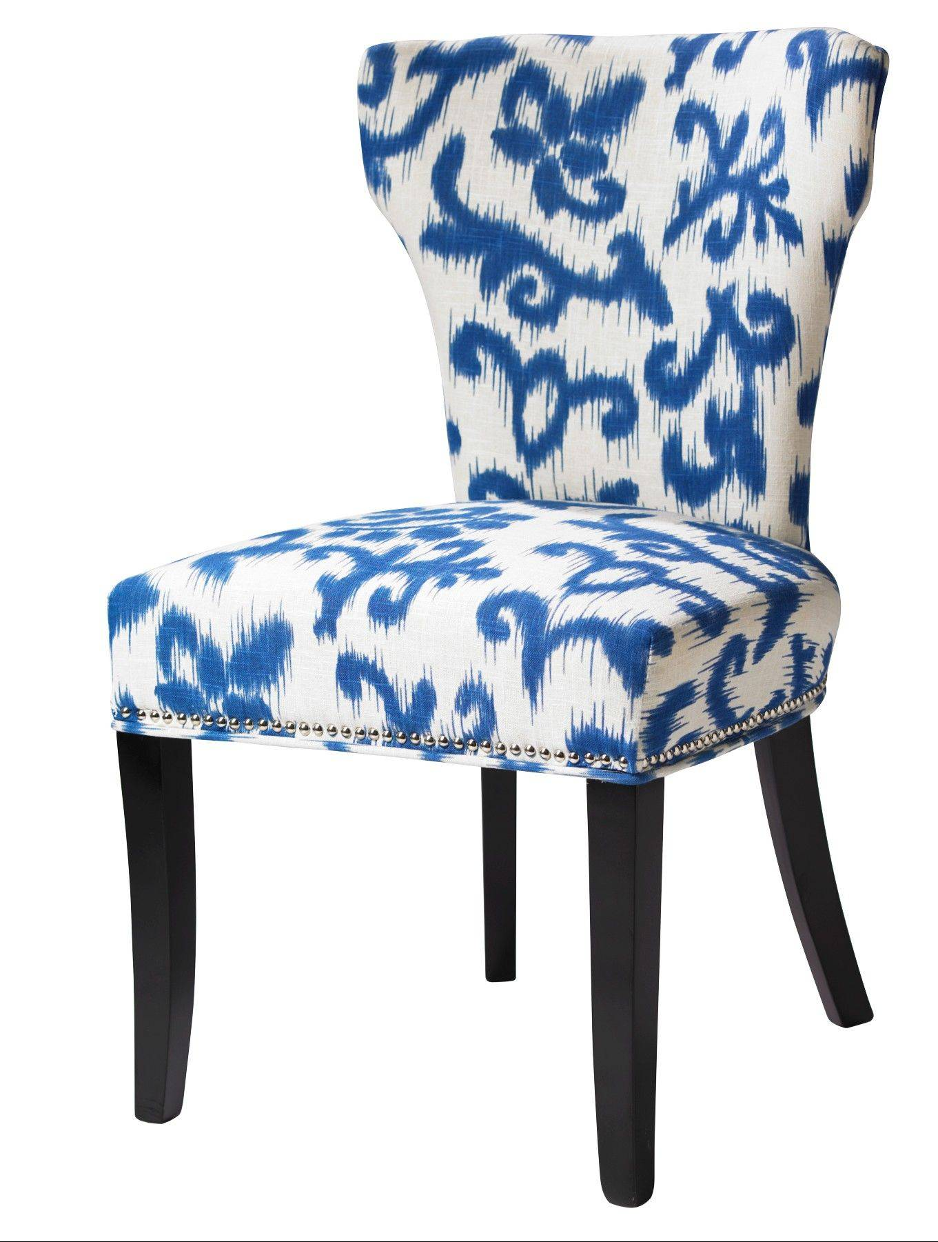 An upholstered chair in a blue and white print from HomeGoods. Blue and white prints are a big trend this spring.